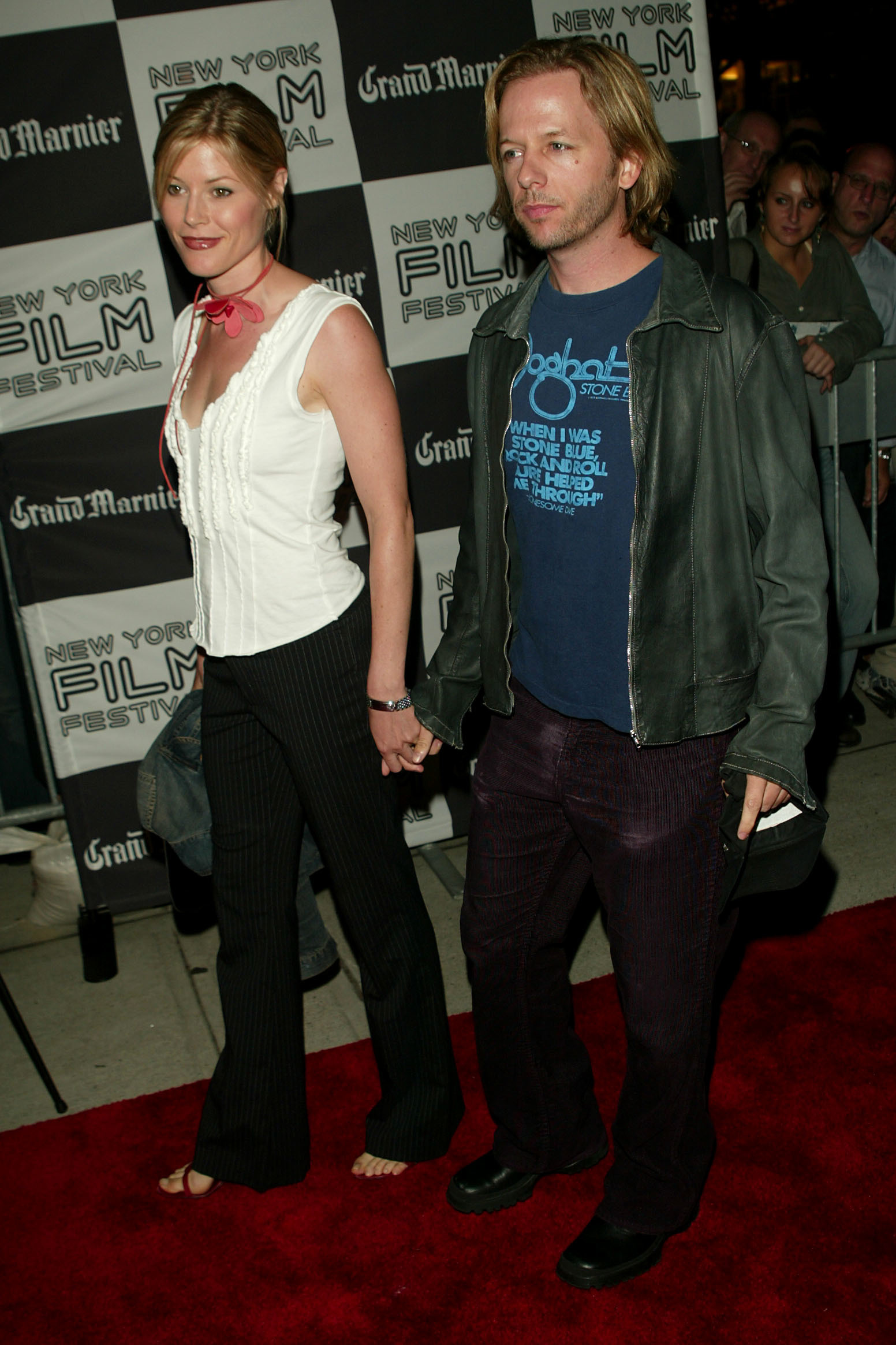 """Julie Bowen and David Spade are pictured at the """"Punch Drunk Love"""" screening during the 40th Annual New York Film Festival sponsored by Grand Marnier at Alice Tully Hall at Lincoln Center in New York City on Oct. 5, 2002."""