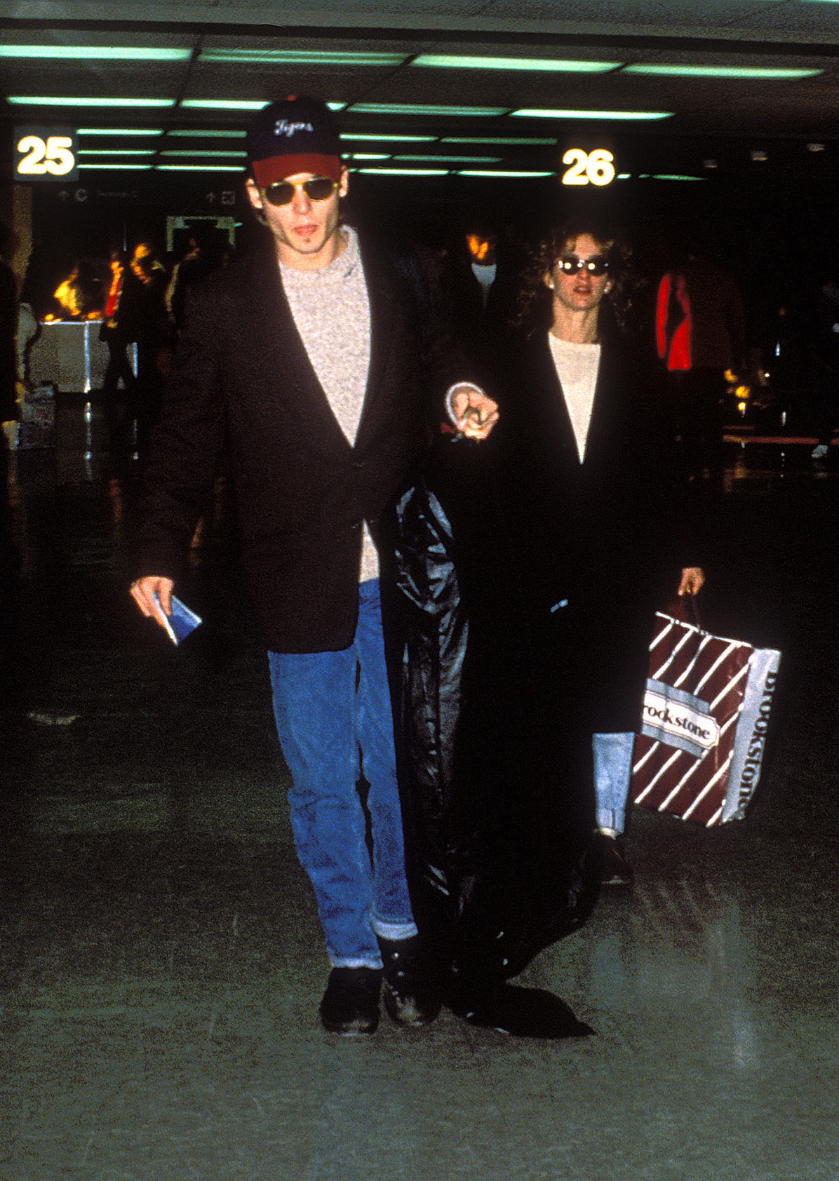 Johnny Depp and Jennifer Grey are pictured at an American airport on June 17, 1989.