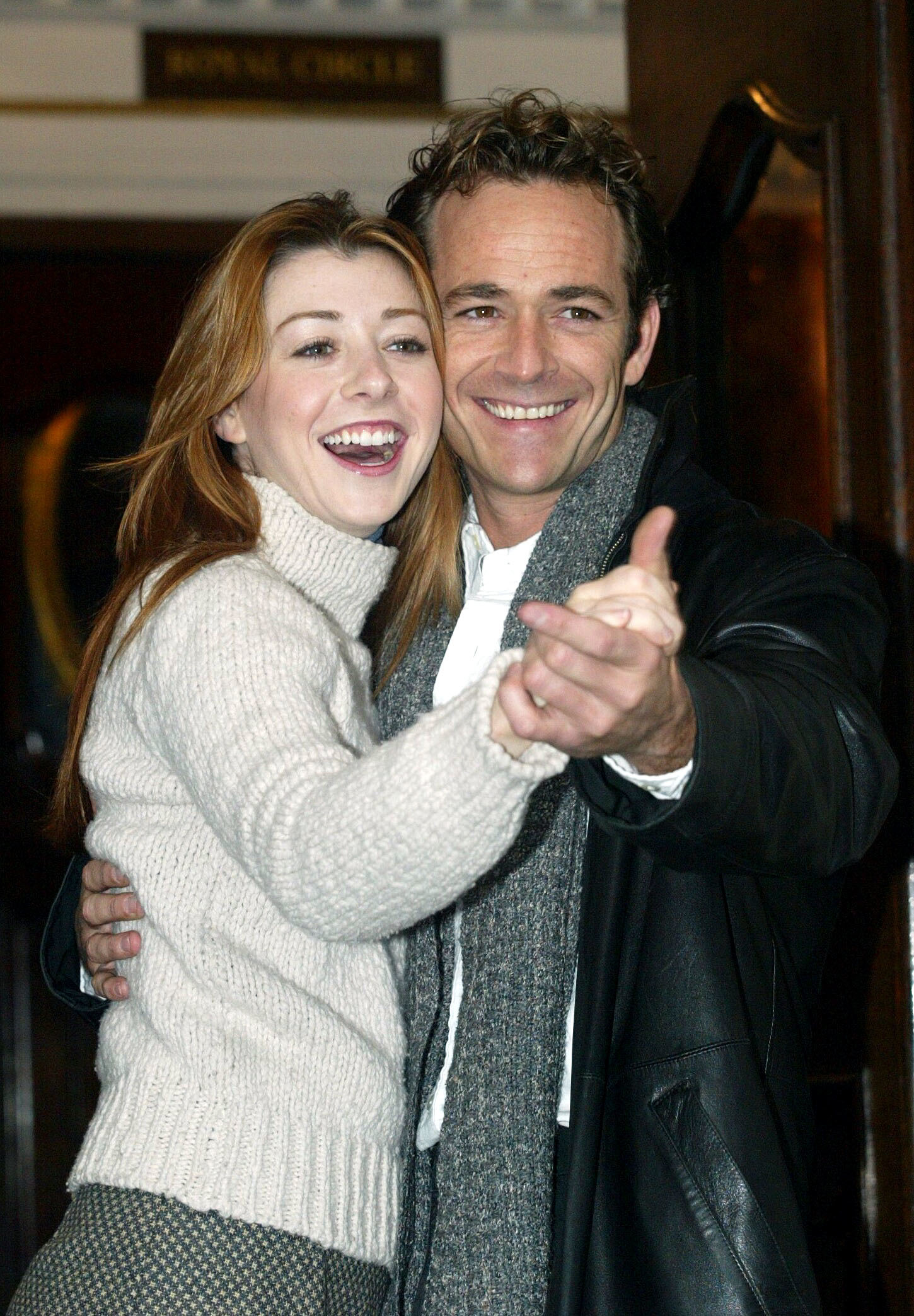 """Alyson Hannigan and Luke Perry appear in a promotional photo from their play """"When Harry Met Sally"""" in London on Jan. 8, 2004."""