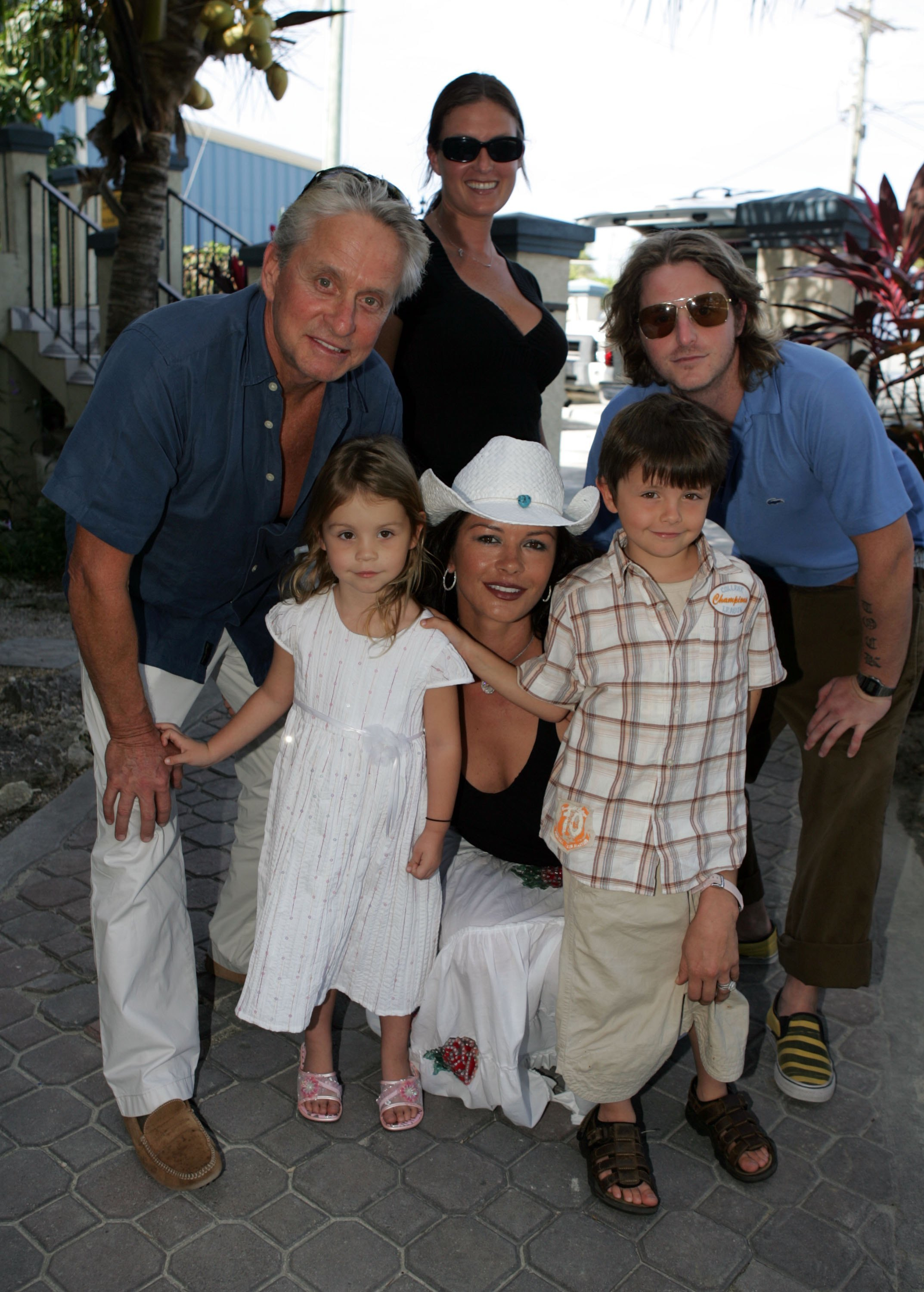 Michael Douglas, Catherine Zeta Jones, their kids Carys and Dylan, his son from a previous relationship,  Cameron Douglas, and Cameron's then girlfriend, Kelly Sott, pose for a photo at Provo airport in Turks and Caicos on Jan. 5, 2007.