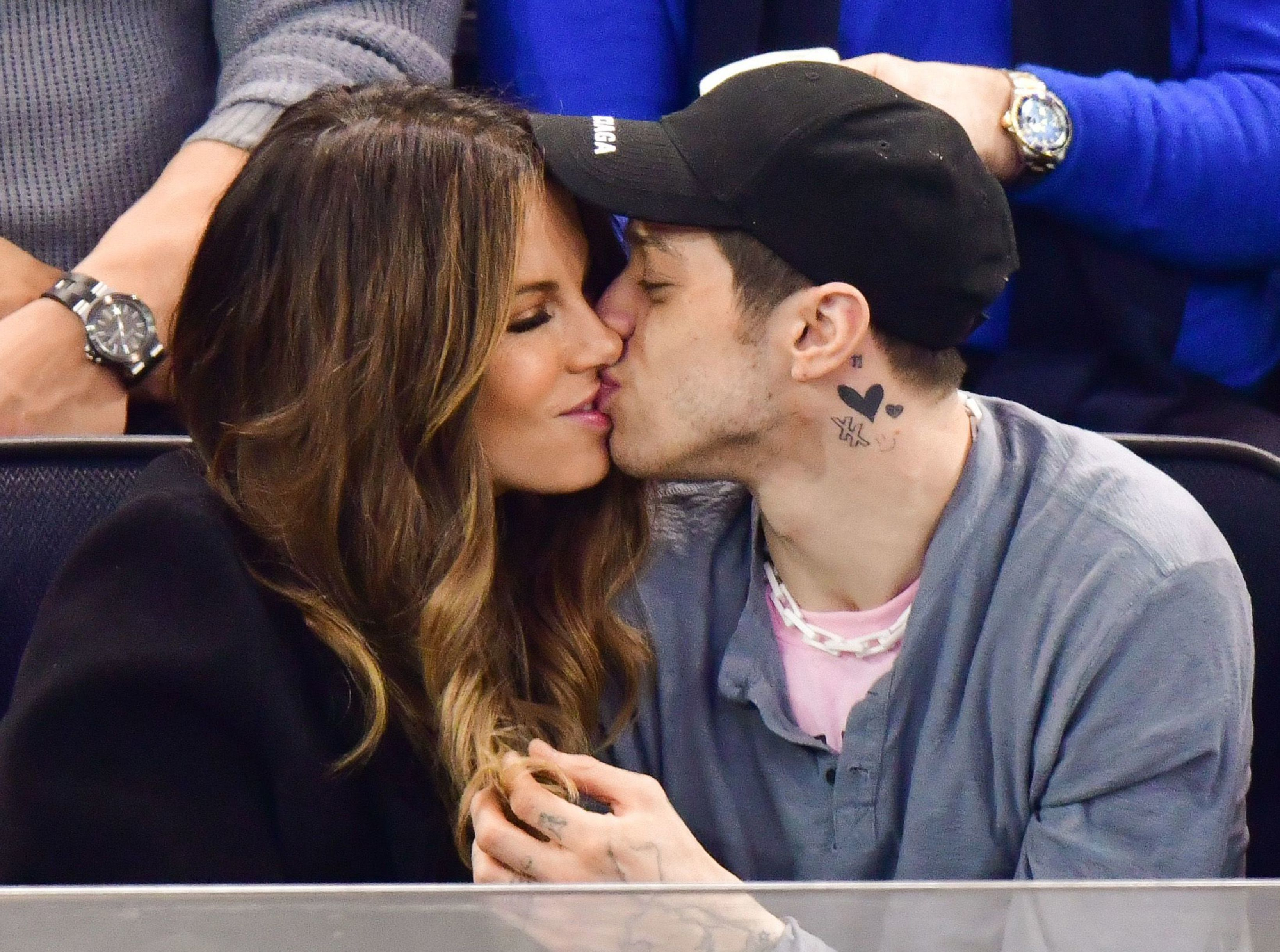 Kate Beckinsale and Pete Davidson kiss during a New York Rangers hockey game at Madison Square Garden in New York City on March 3, 2019.