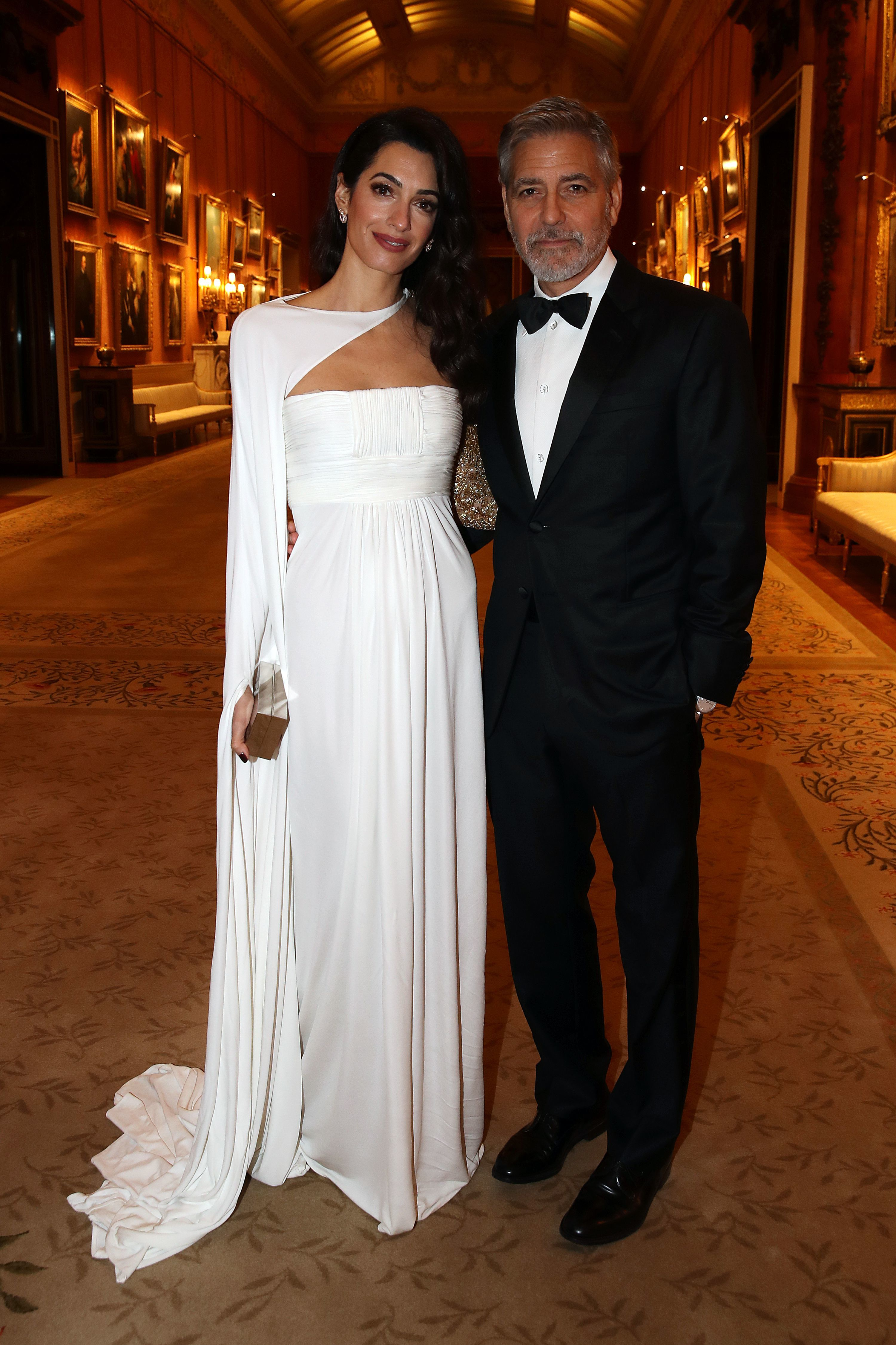 """Amal Clooney and George Clooney attend """"The Prince's Trust"""" Dinner at Buckingham Palace in London on March 12, 2019."""