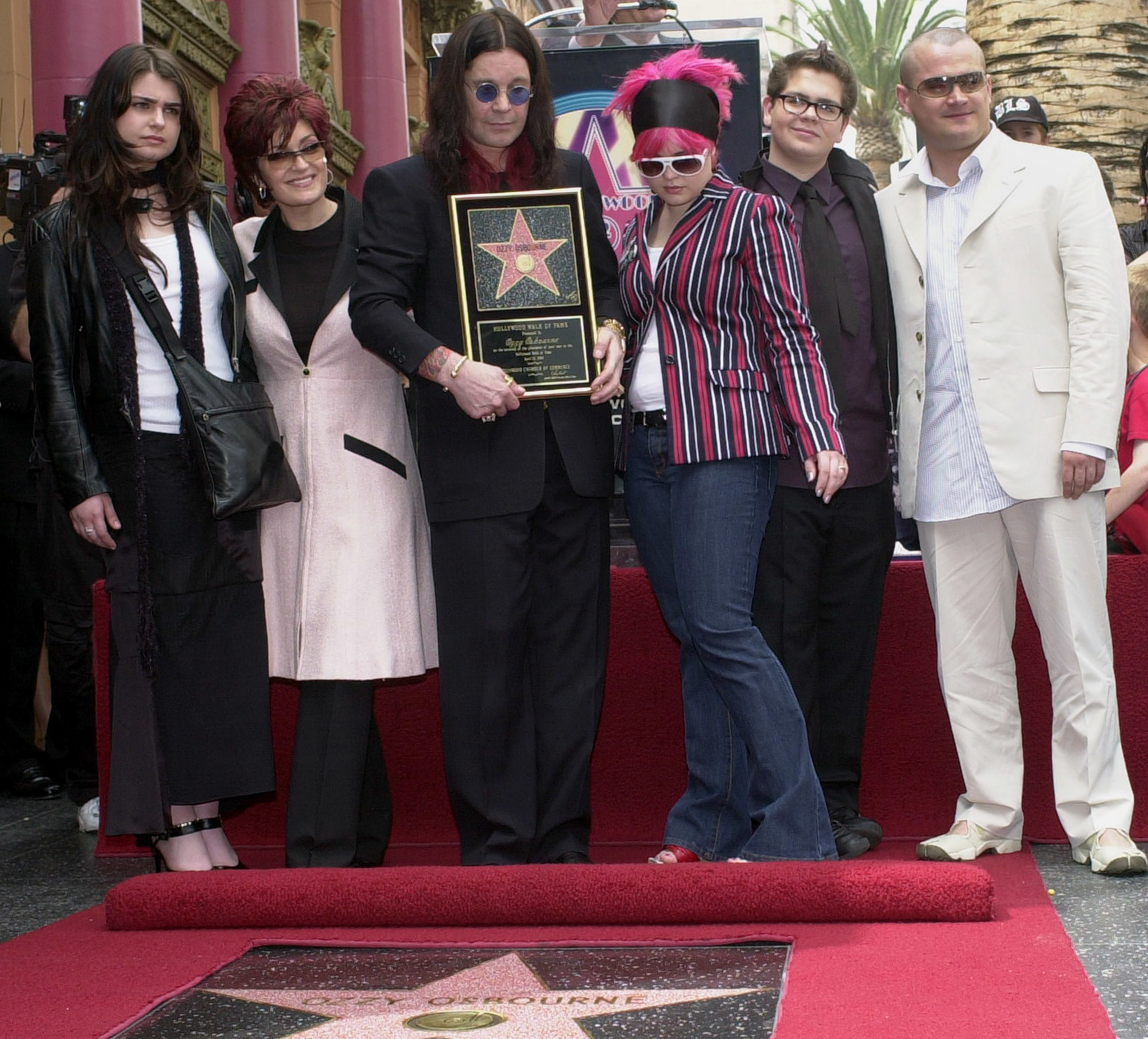 Ozzy Osbourne poses with kids Aimee, Kelly, Jack and Louis and wife Sharon as he's honored with a star on the Hollywood Walk of Fame on April 12, 2002.