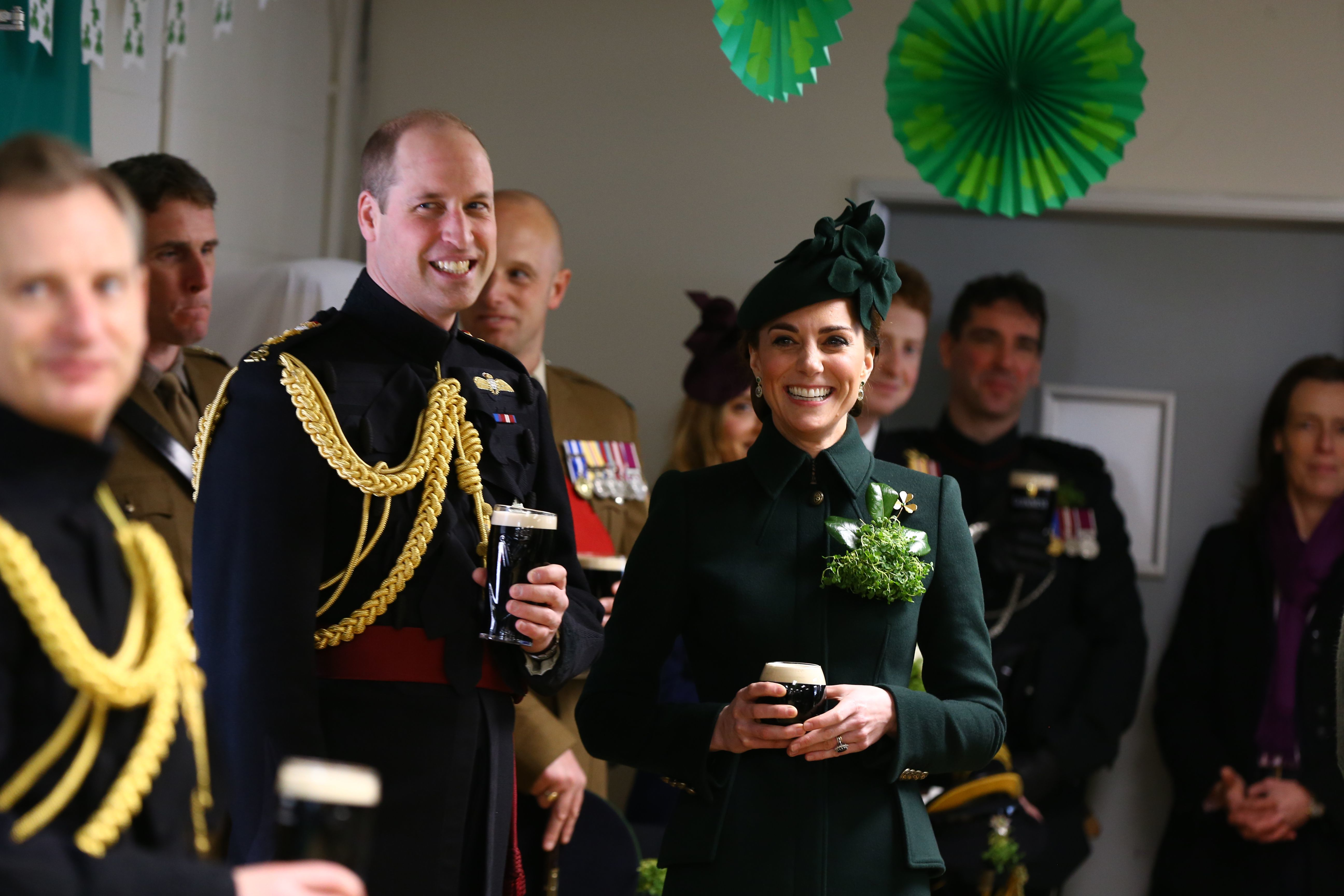 Prince William and Duchess Kate enjoy a pint of Guinness after attending the St Patrick's Day parade at Cavalry Barracks in London on March 17, 2019.