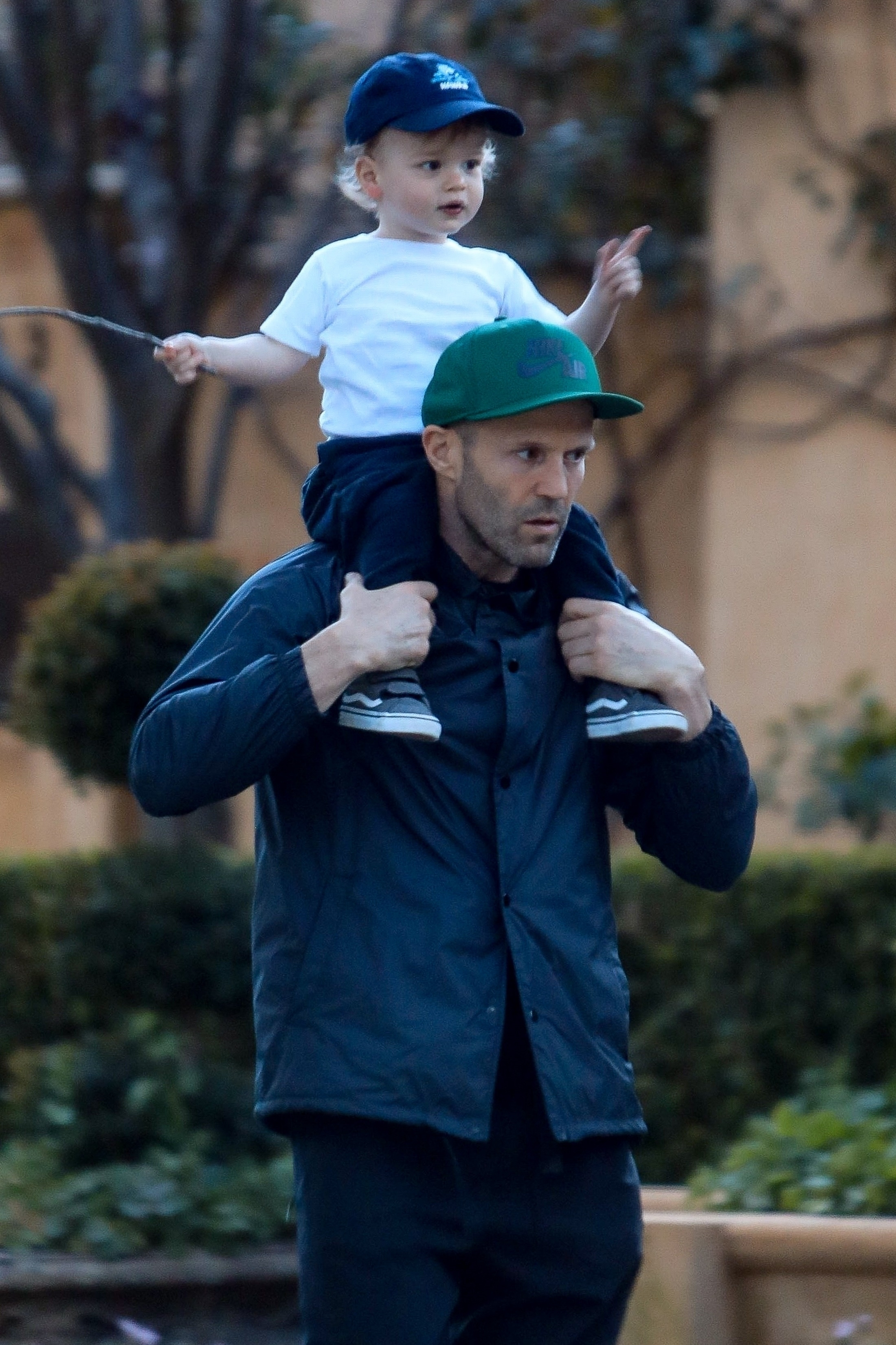 Jason Statham carried his son Jack while taking a walk in the Pacific Palisades section of Los Angeles on March 14, 2019.