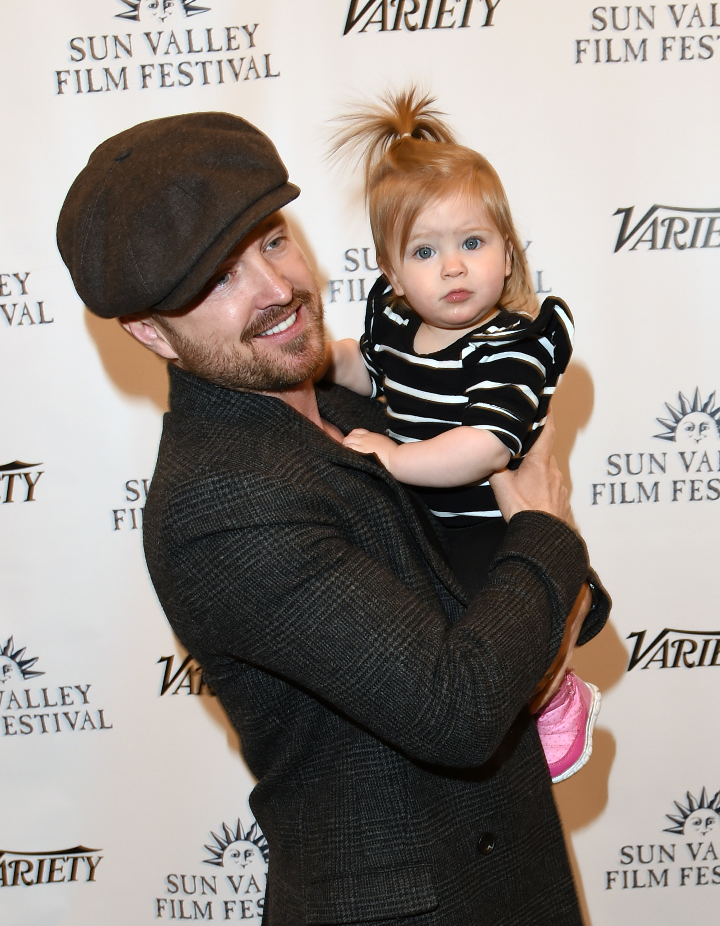 Aaron Paul posed with his adorable daughter story while attending the Sun Valley Film Festival in Sun Valley, Idaho on March 15, 2019.
