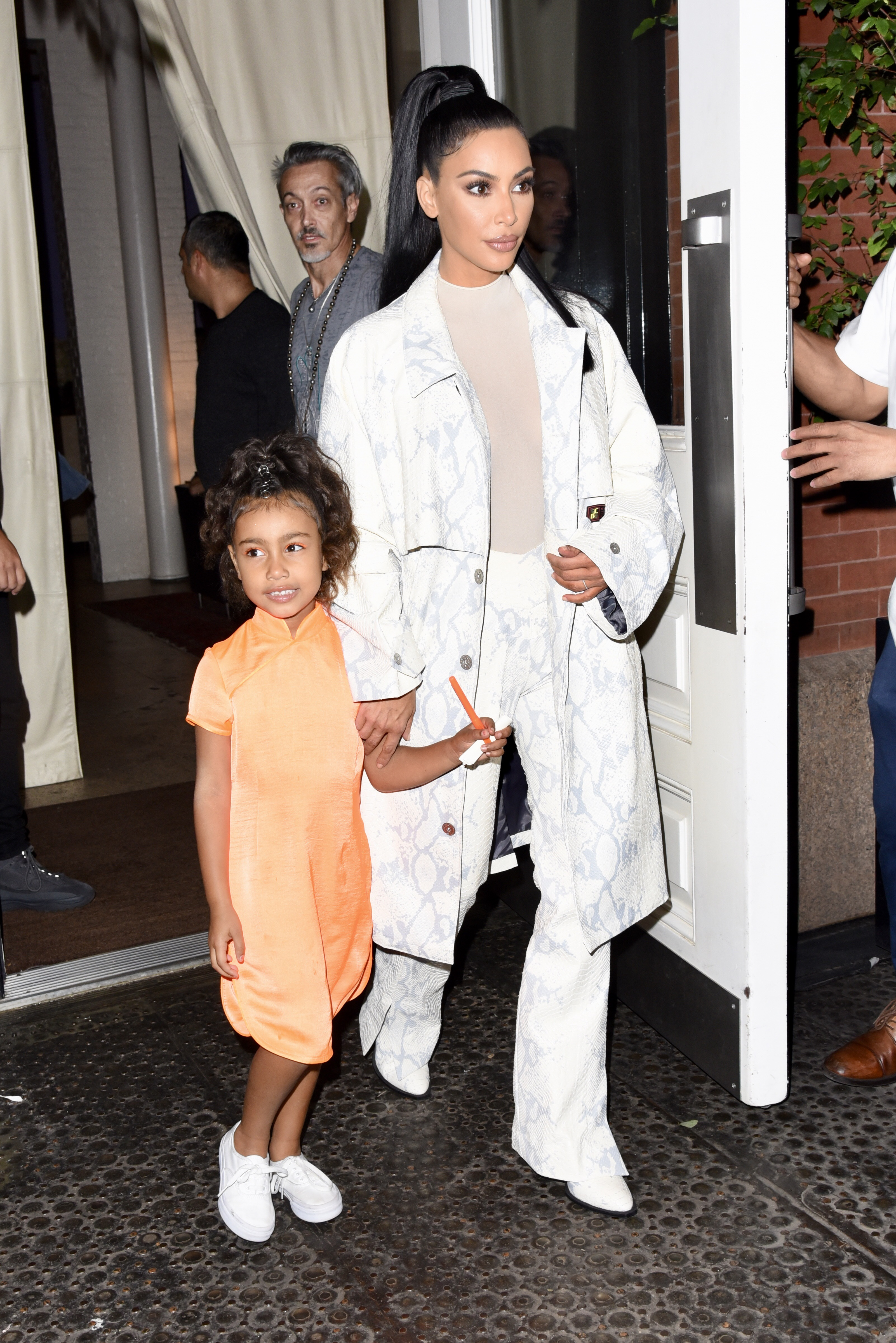 North West and Kim Kardashian West step out in New York City on Sept. 29, 2018.