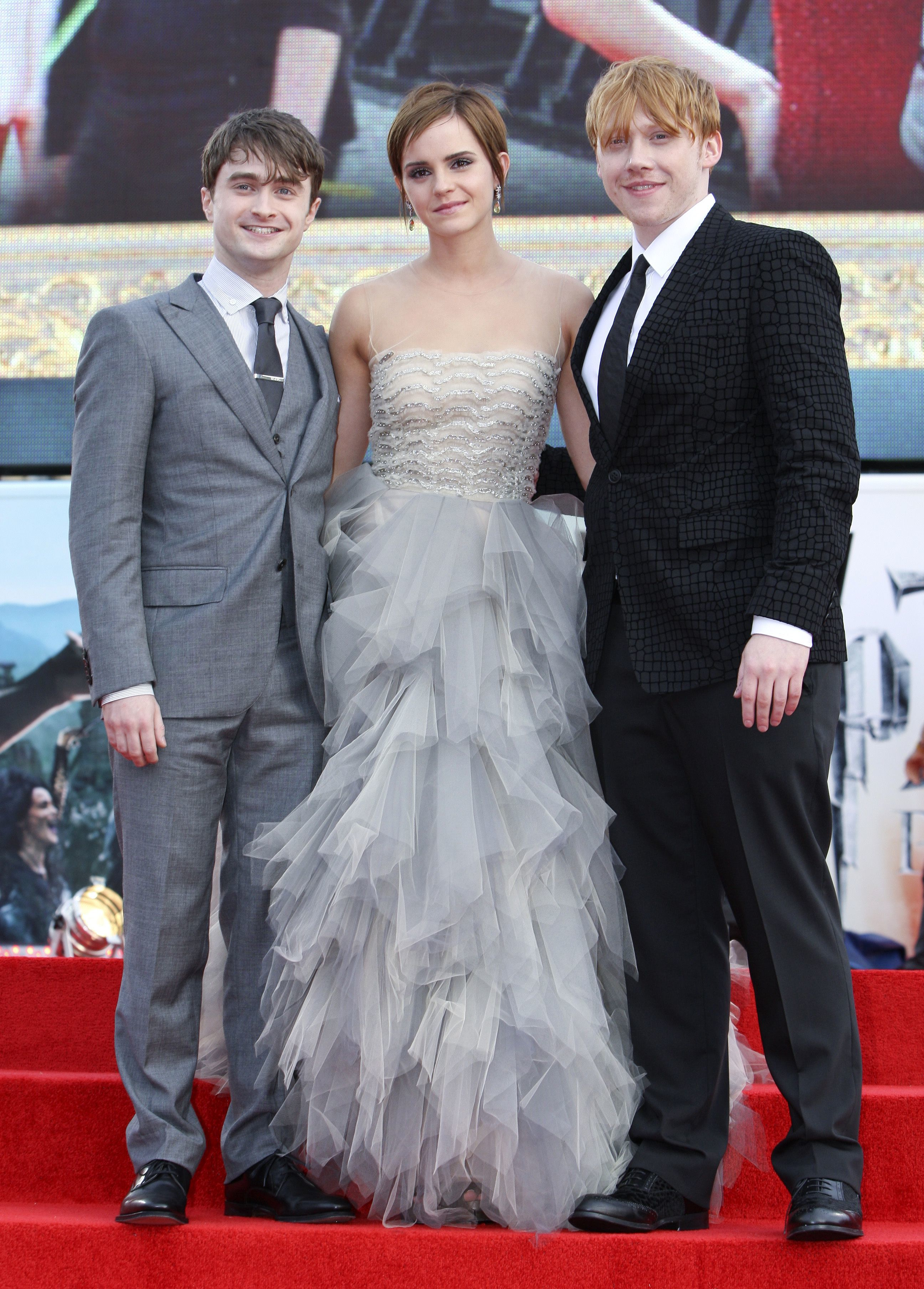 "Daniel Radcliffe, Emma Watson and Rupert Grint attend the ""Harry Potter and the Deathly Hallows: Part 2"" in London on July 7, 2011."