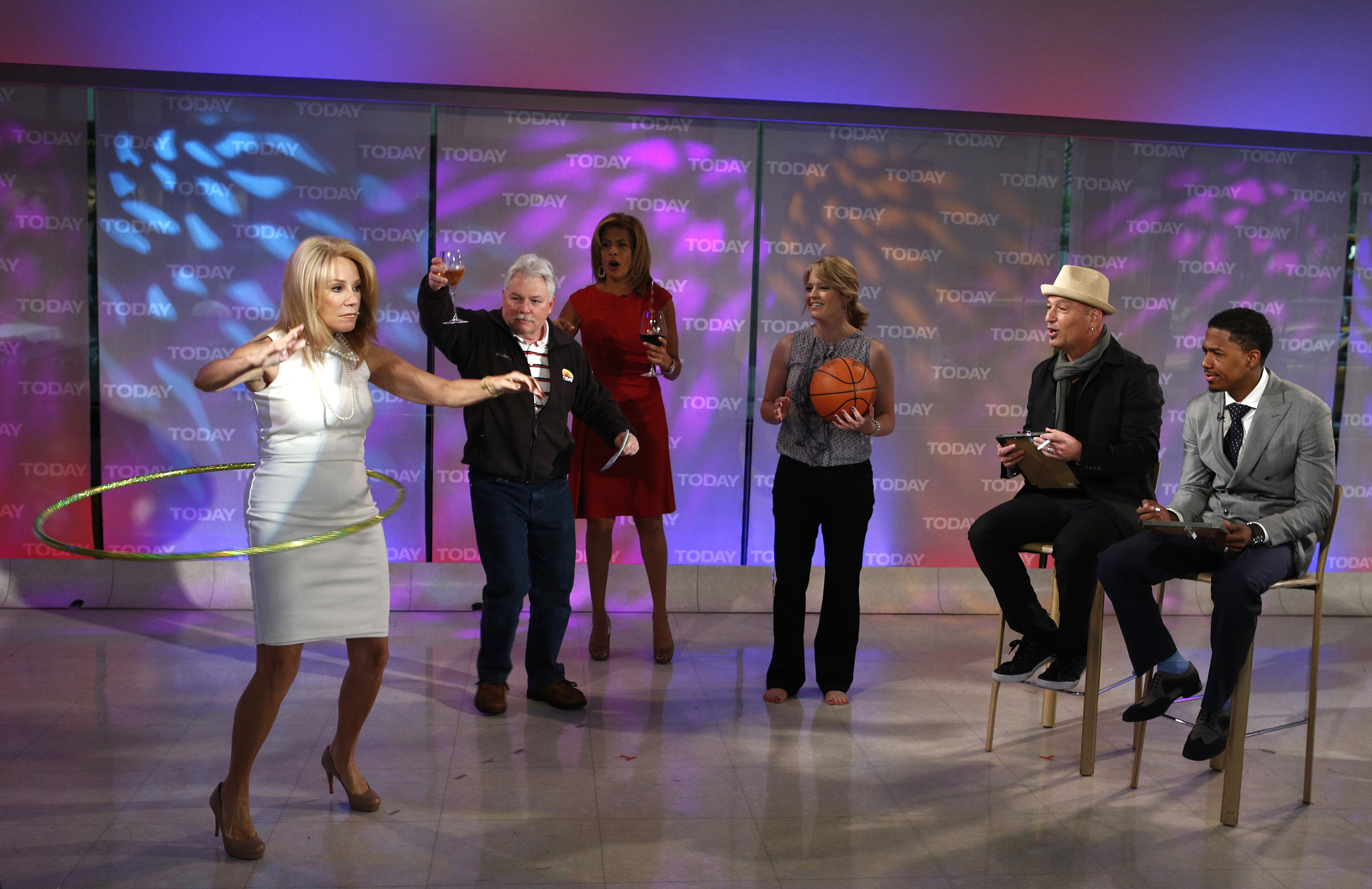 """Kathie Lee Gifford, Hoda Kotb, Howie Mandel and Nick Cannon appear on NBC News' """"Today"""" show in 2012."""