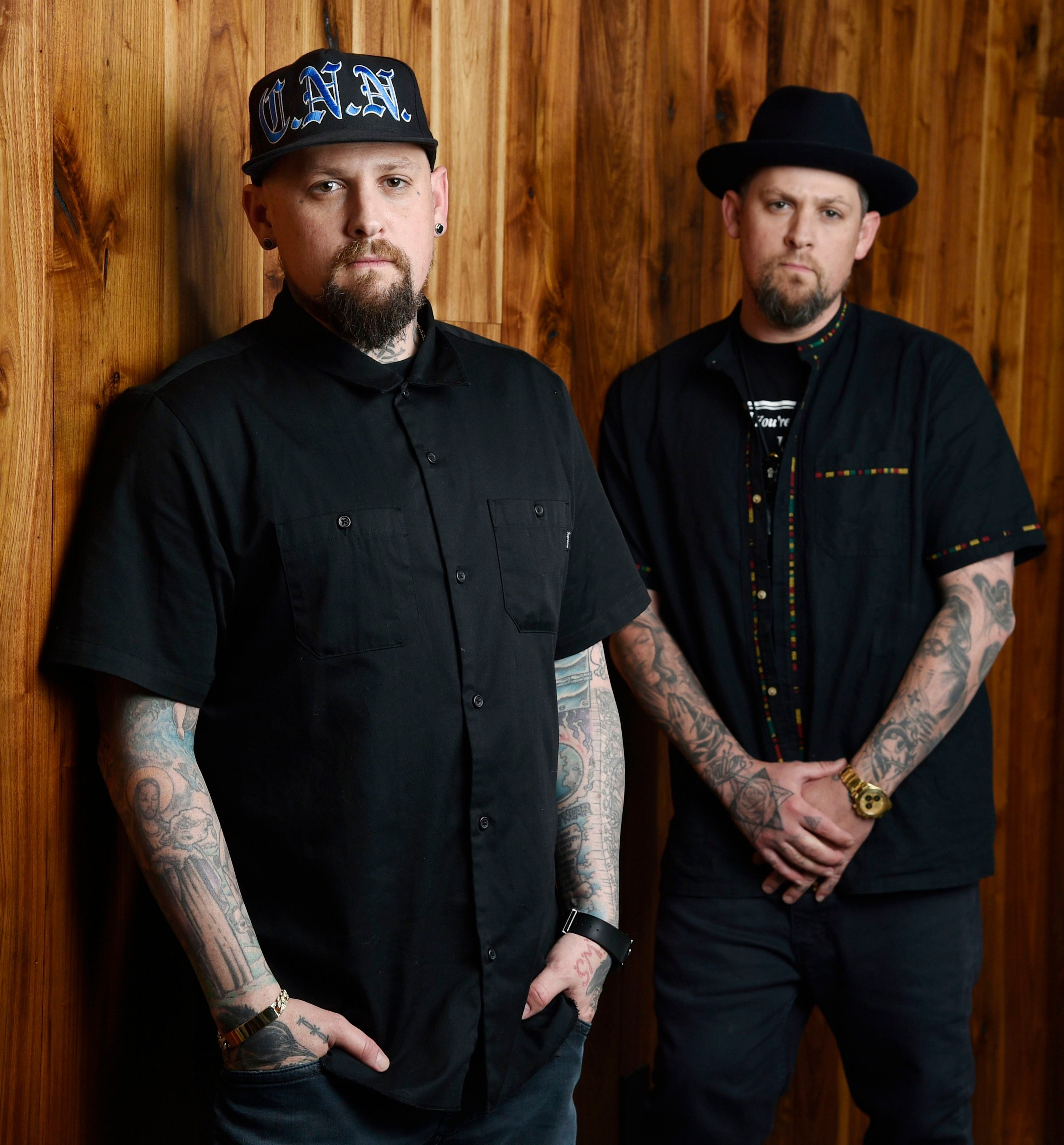 Benji Madden, left, and his twin brother Joel Madden of the band Good Charlotte pose for a portrait, in Burbank, Calif. on July 10, 2018.