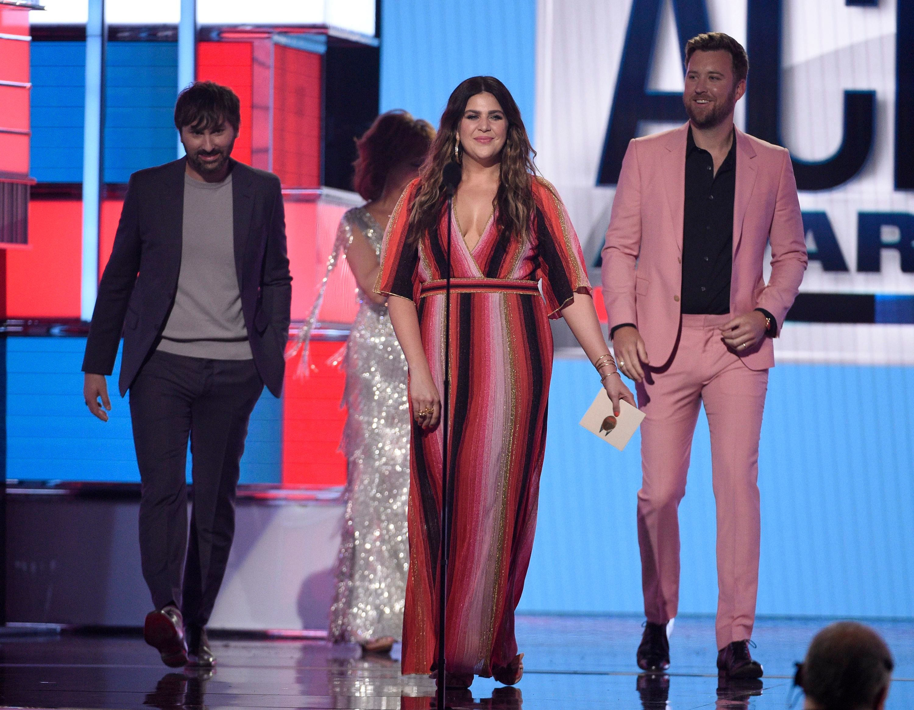 Dave Haywood, Hillary Scott and Charles Kelley, of Lady Antebellum, present the award for song of the year at the 54th annual Academy of Country Music Awards in Las Vegas on April 7, 2019.
