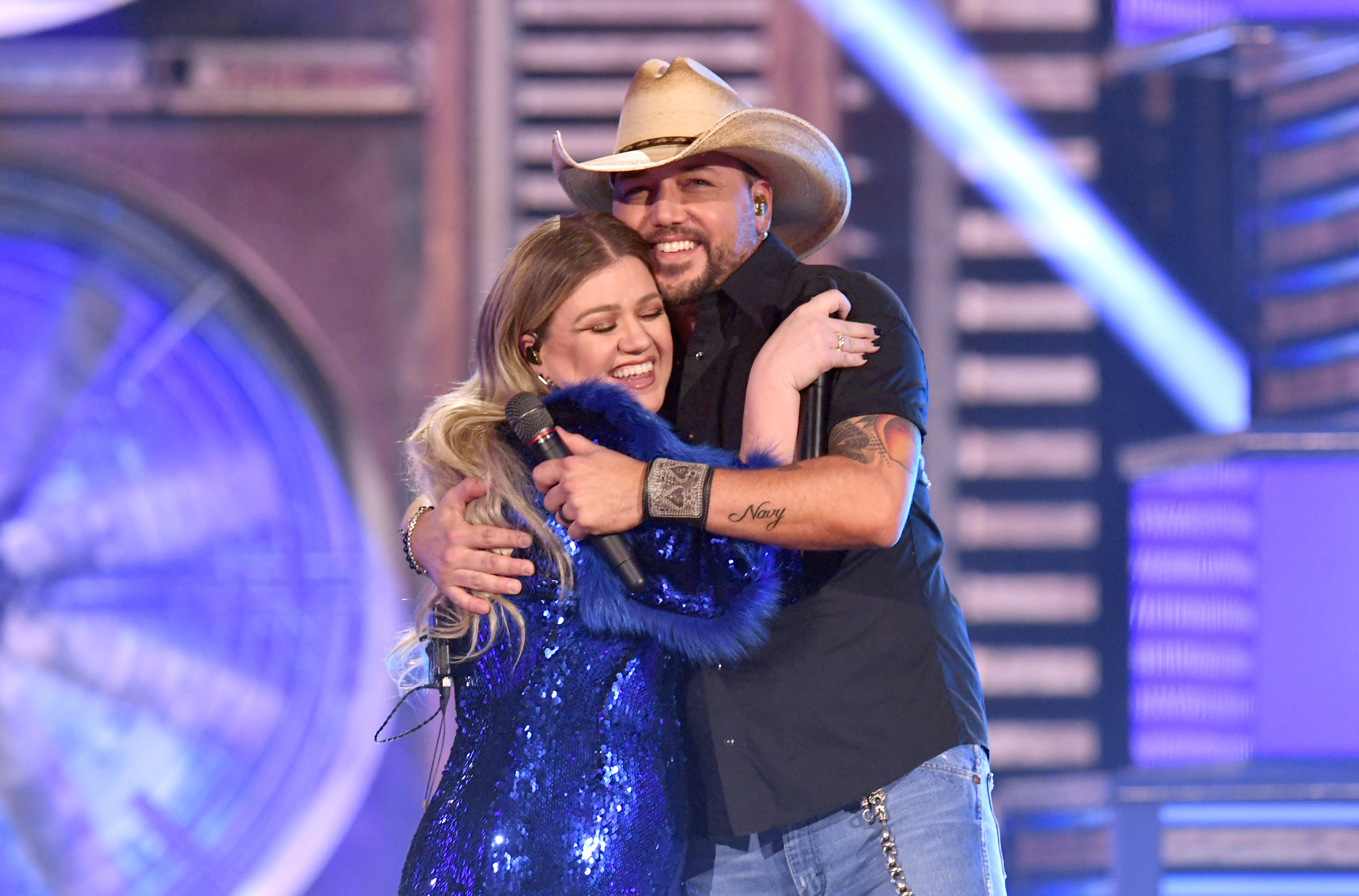 Kelly Clarkson and Jason Aldean perform onstage during the 54th Academy Of Country Music Awards in Las Vegas on April 7, 2019.