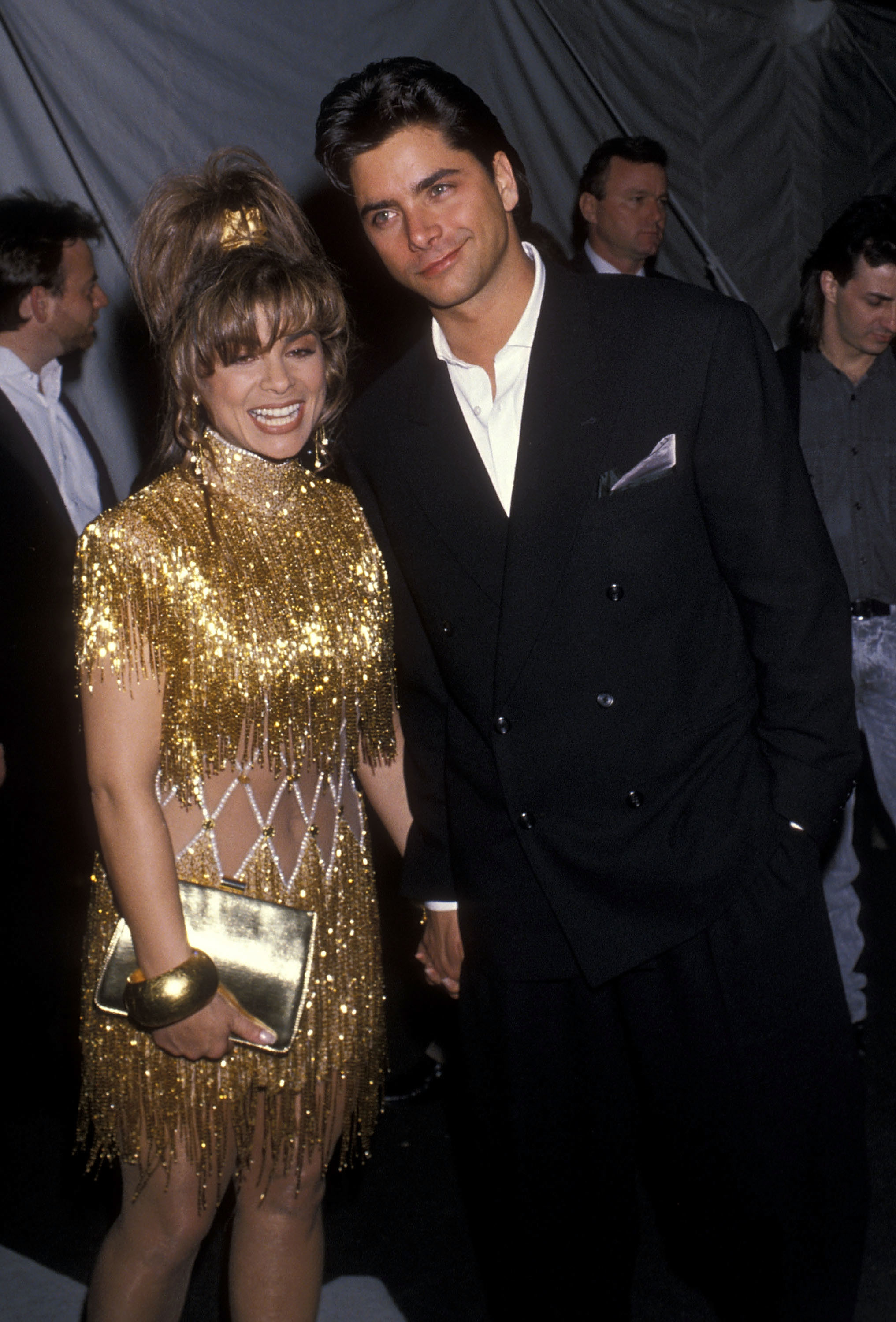 Paula Abdul and John Stamos attend the 32nd Annual Grammy Awards at the Shrine Auditorium in Los Angeles on Feb. 21, 1990.