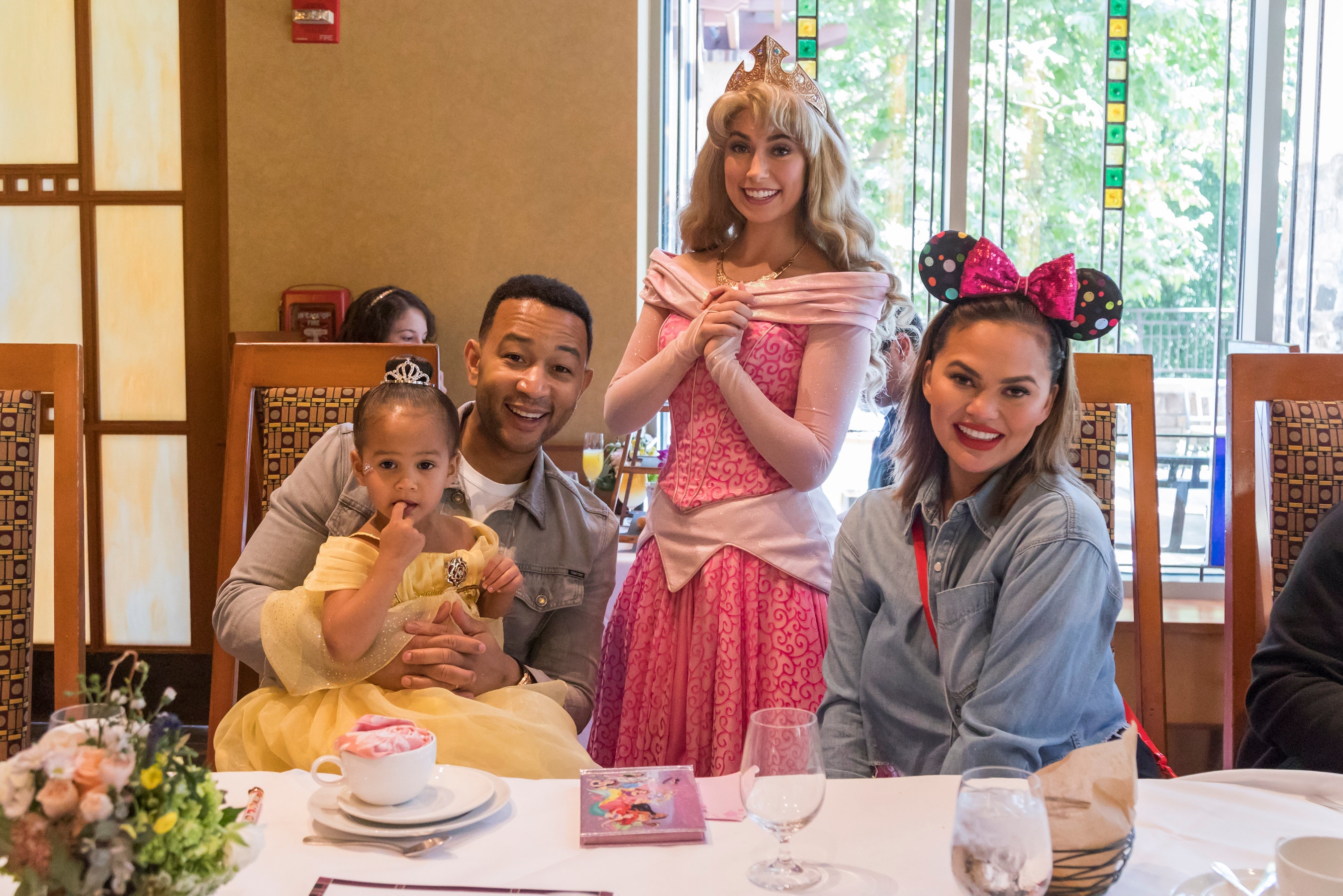 John Legend, Chrissy Teigen and daughter Luna Stephens pose with Princess Aurora at Disneyland in Anaheim, California, on April 12, 2019, during a trip to celebrate Luna's third birthday.