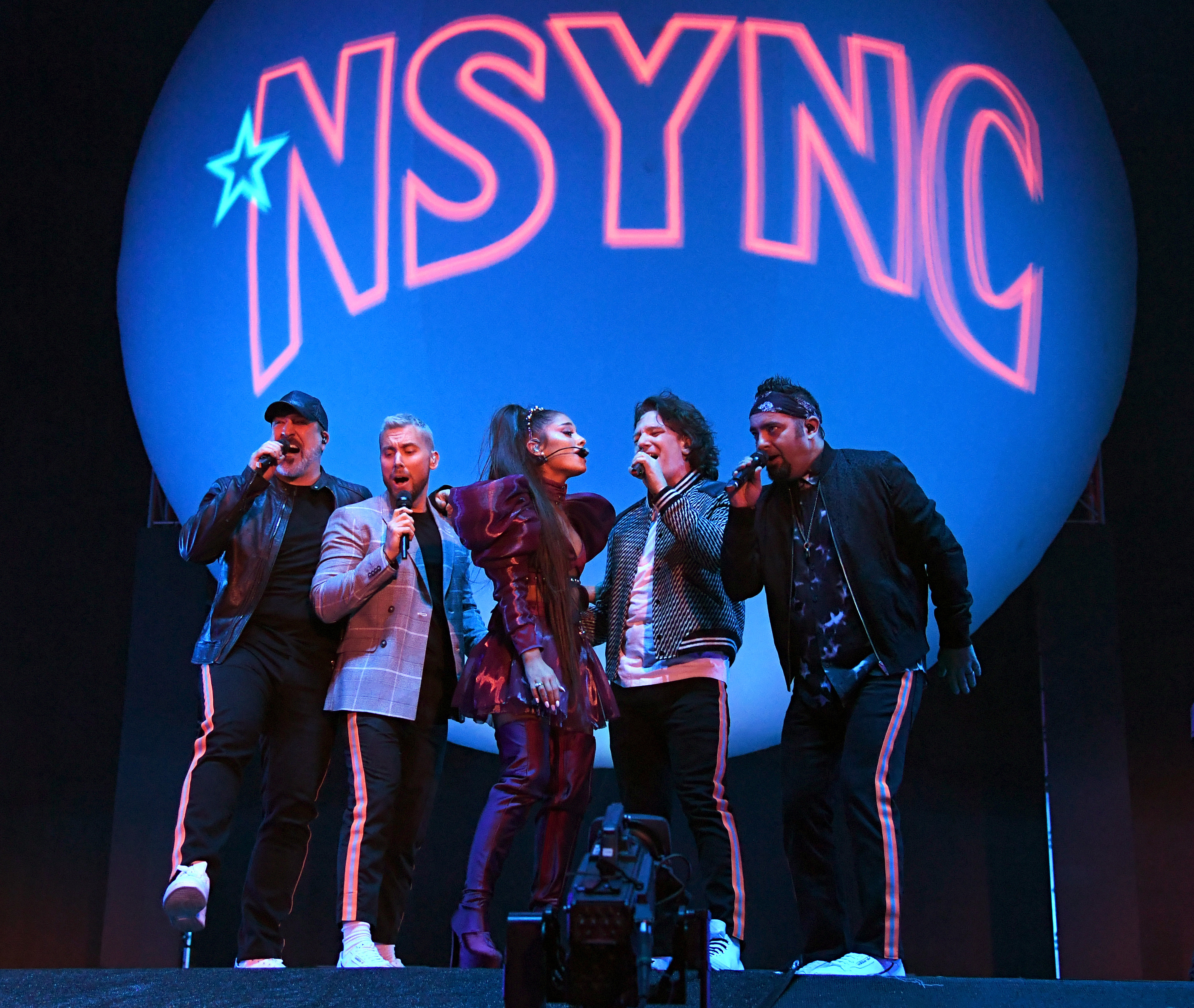 Ariana Grande performs with *NSYNC members Joey Fatone, Lance Bass, JC Chasez and Chris Kirkpatrick on the Coachella Stage during the Coachella Valley Music and Arts Festival in Indio, California, on April 14, 2019.