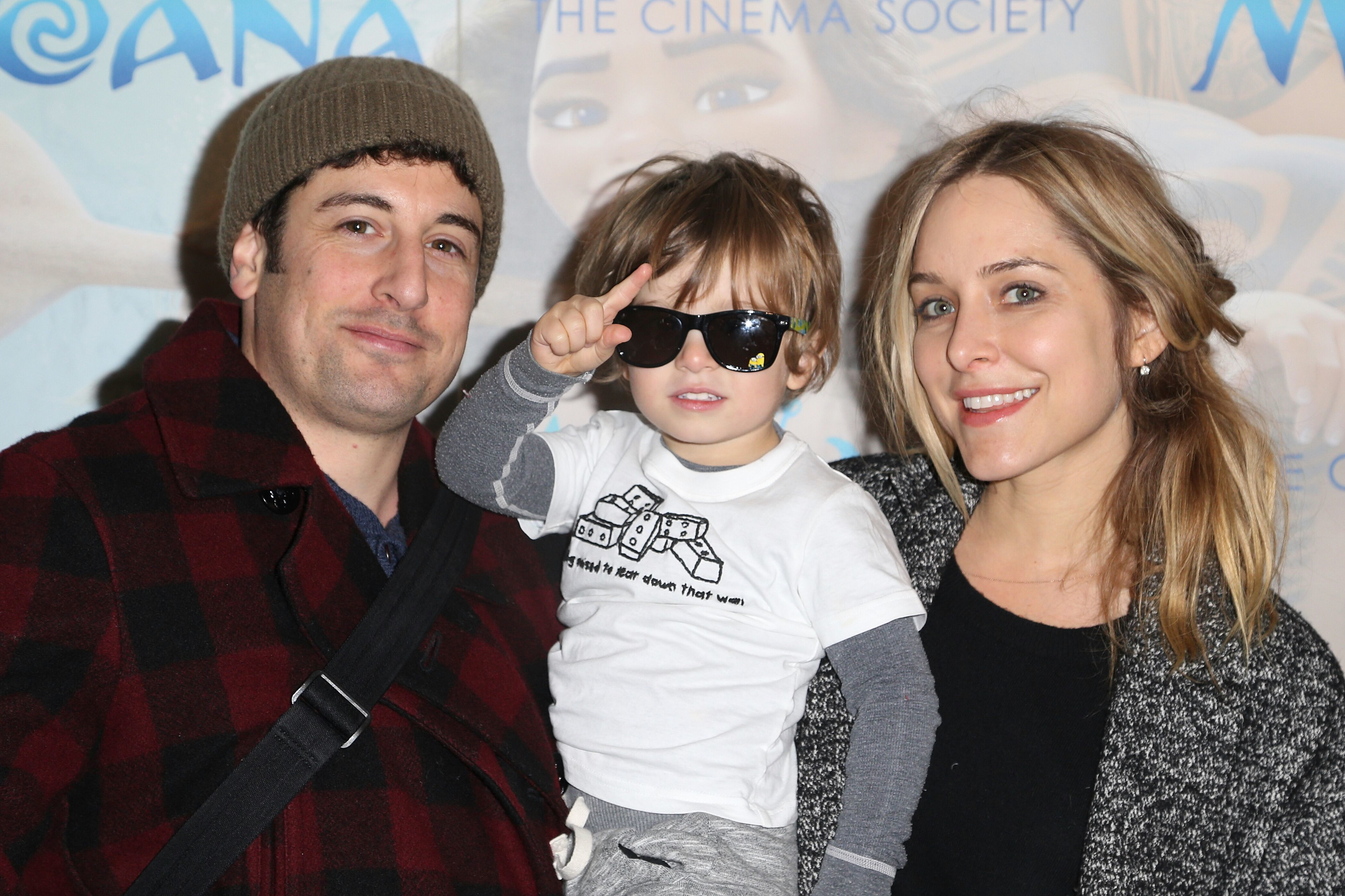 """Jason Biggs, Jenny Mollen and their son, Sid, attend the screening of """"Moana"""" in New York City on Nov. 20, 2016."""