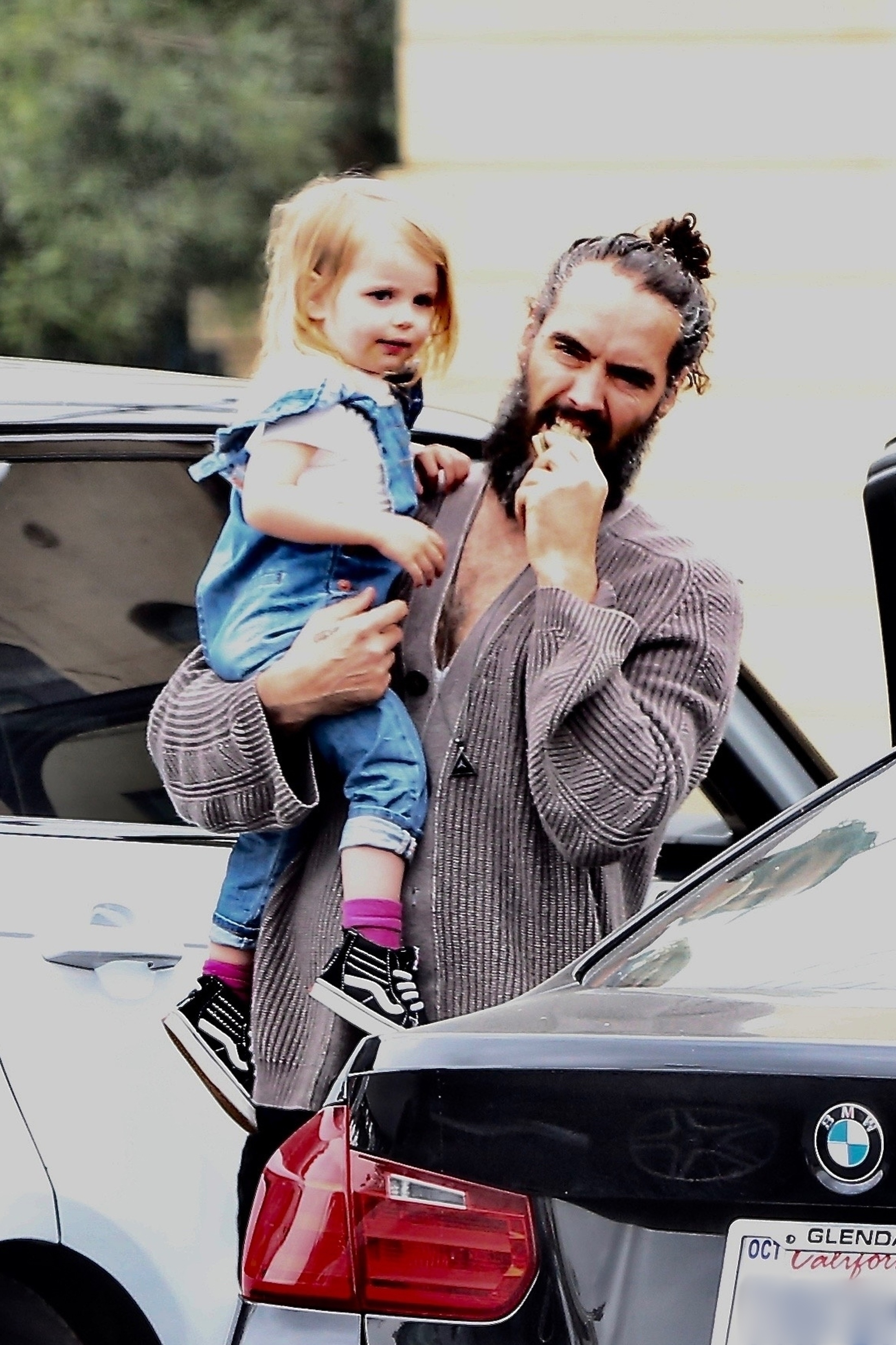 Russell Brand was seen carrying his daughter, Mabel, to lunch in the Los Feliz section of Los Angeles on April 20, 2019.
