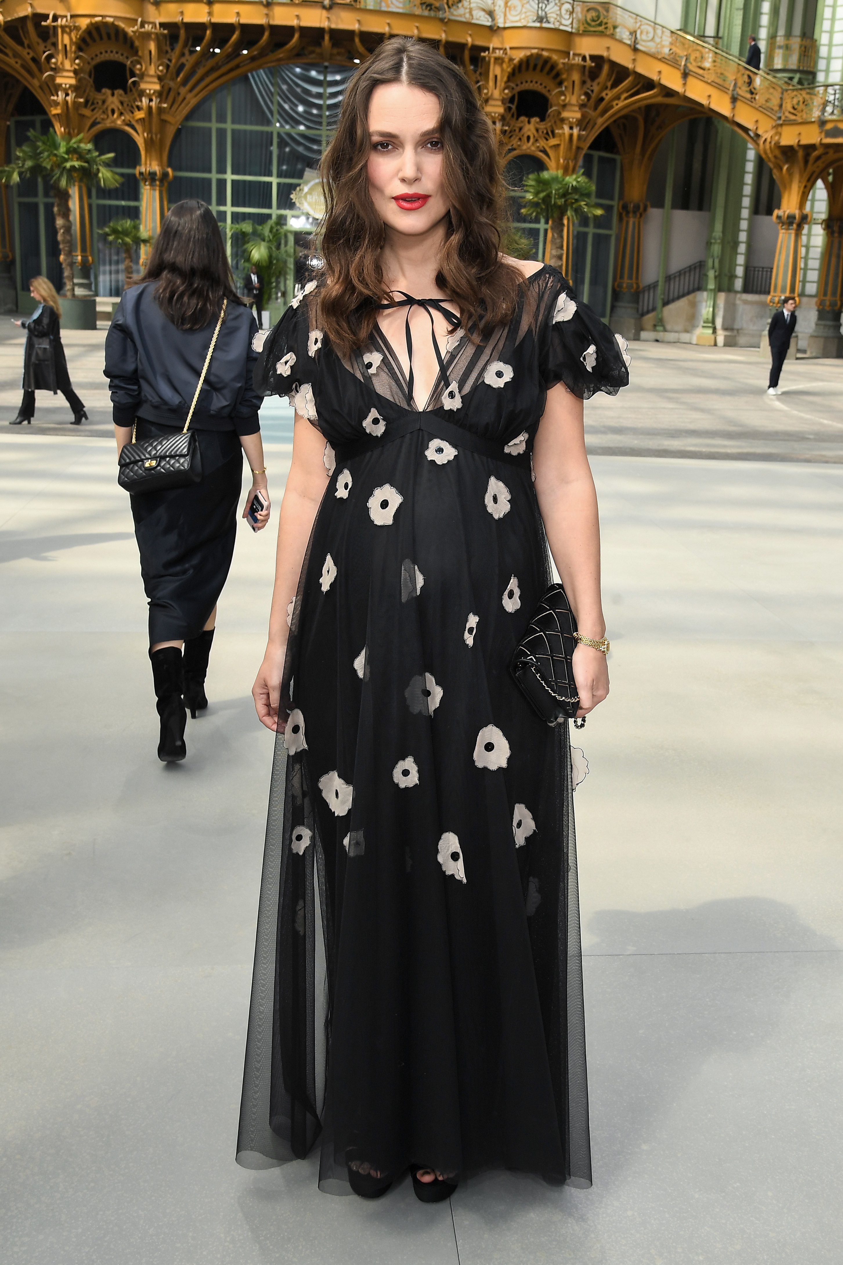 Keira Knightley appears in the front row of the Chanel Cruise 2020 show in Paris on May 3, 2019.