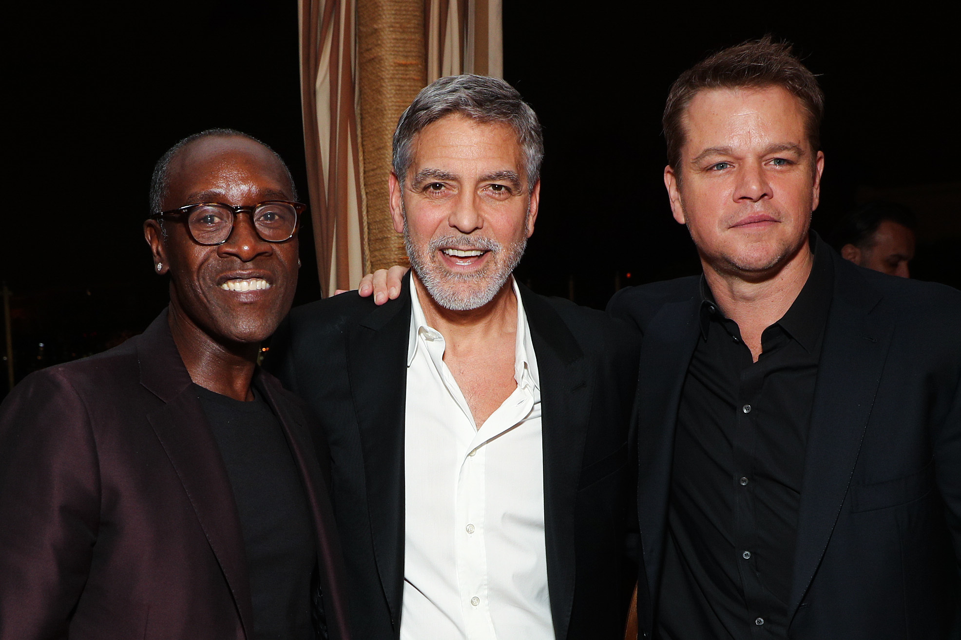 """Don Cheadle, George Clooney and Matt Damon arrive at the premiere of """"Catch 22"""" in Los Angeles on May 7, 2019."""