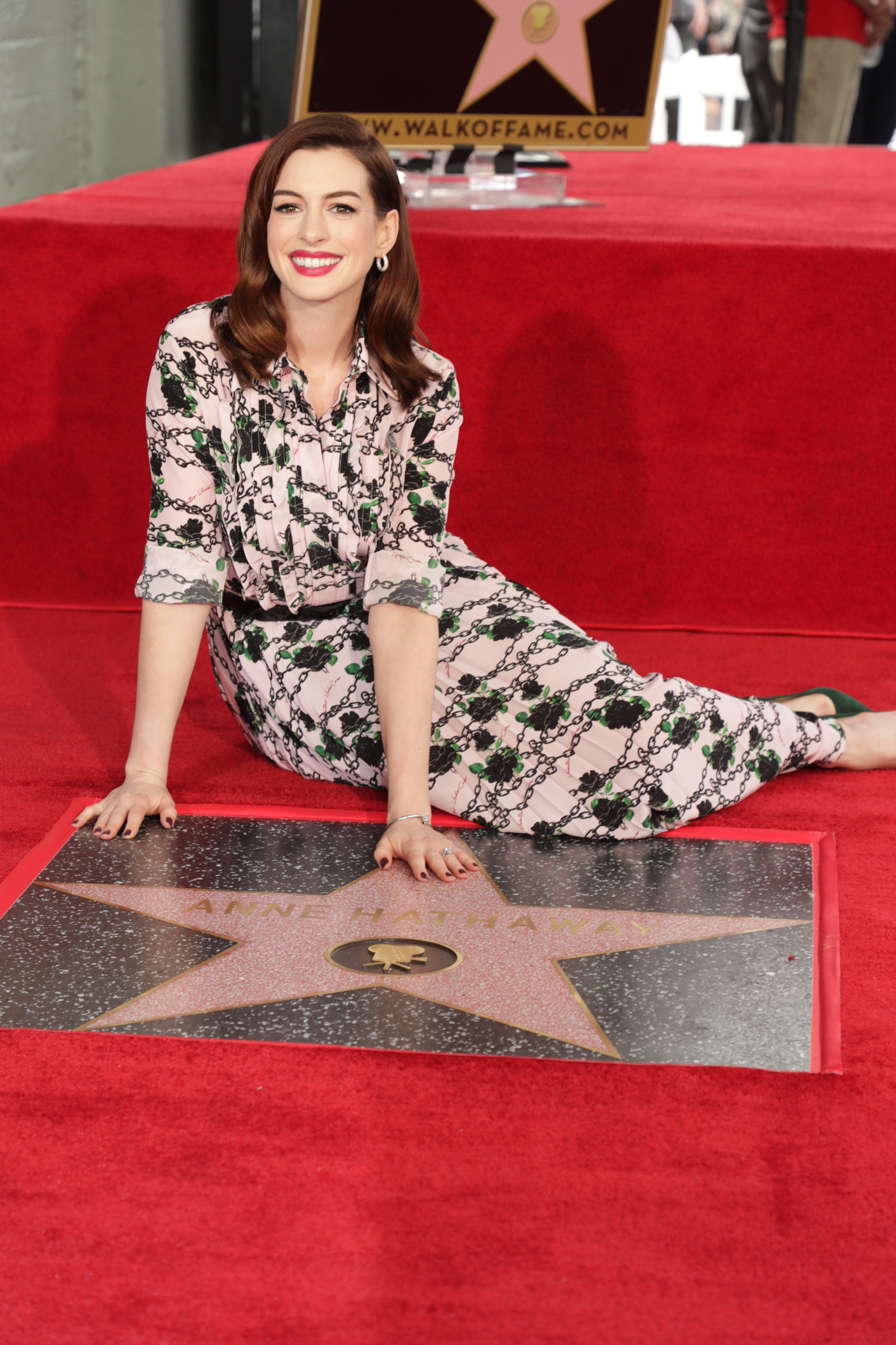 Anne Hathaway poses at her Hand and Footprint ceremony in Los Angeles on May 9, 2019.