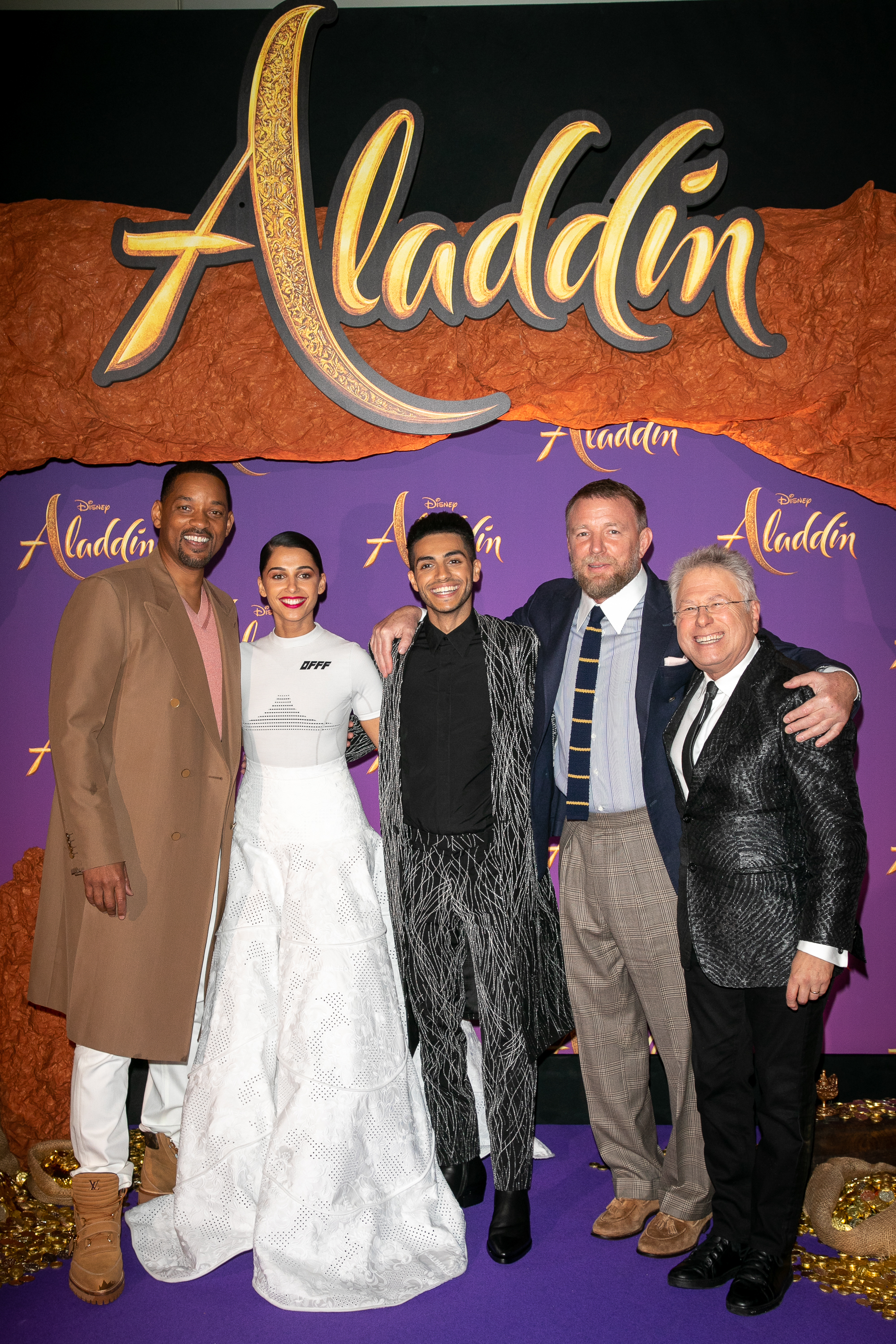 """Will Smith, Naomi Scott, Mena Massoud, Guy Ritchie and Alan Menken attend the """"Aladdin"""" Paris Gala Screening at Cinema Le Grand Rex in Paris, France on May 8, 2019."""