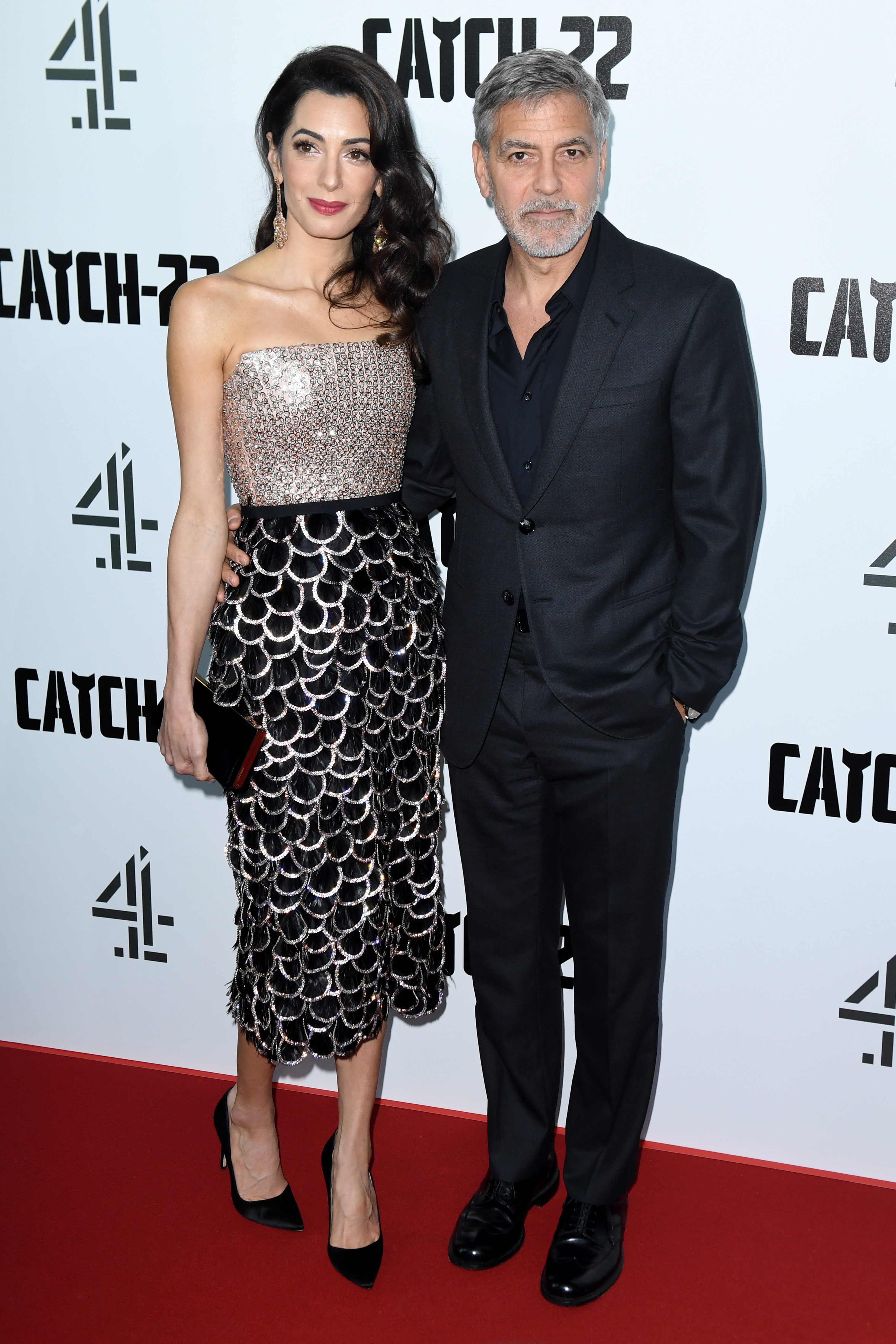"Amal Clooney and George Clooney attend the ""Catch 22"" TV show premiere in London on May 15, 2019."