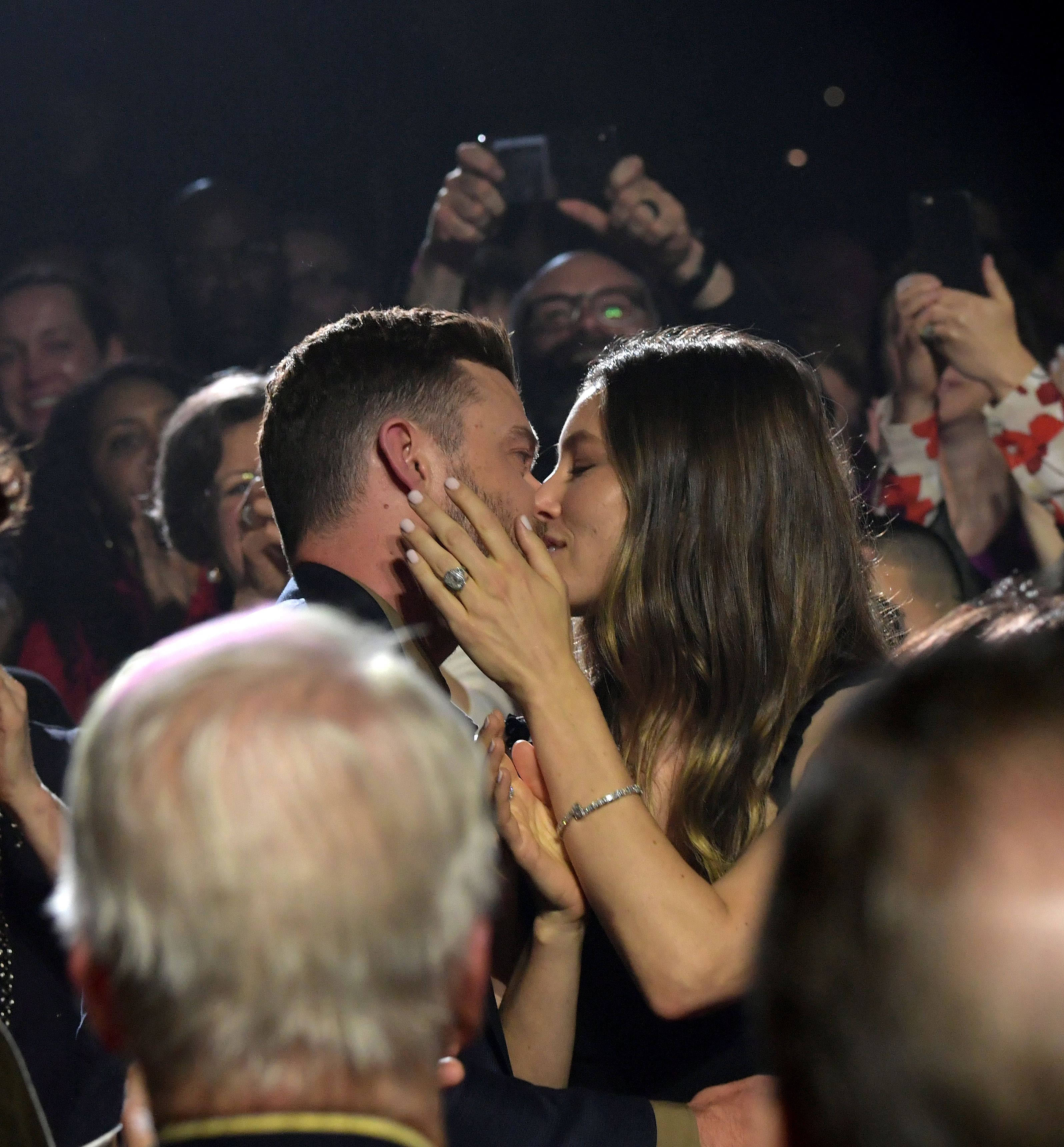 Justin Timberlake kisses wife Jessica Biel at the annual Berklee College of Music Commencement concert at Agganis Arena at Boston University in Boston on May 10, 2019.