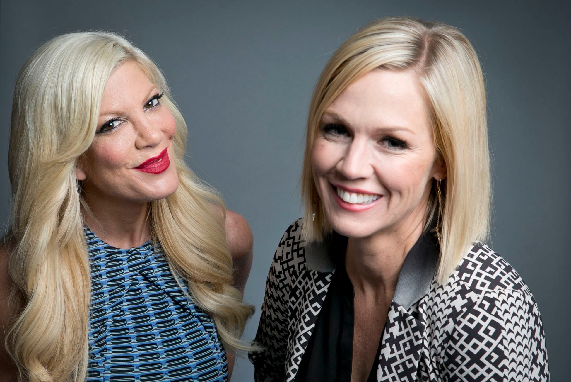 """Original co stars of the Fox television series """"Beverly Hills, 90210"""" actresses Tori Spelling, left, and Jennie Garth, pose for a portrait in promotion of their upcoming ABC Family series """"Mystery Girls"""" in 2014, in New York City."""