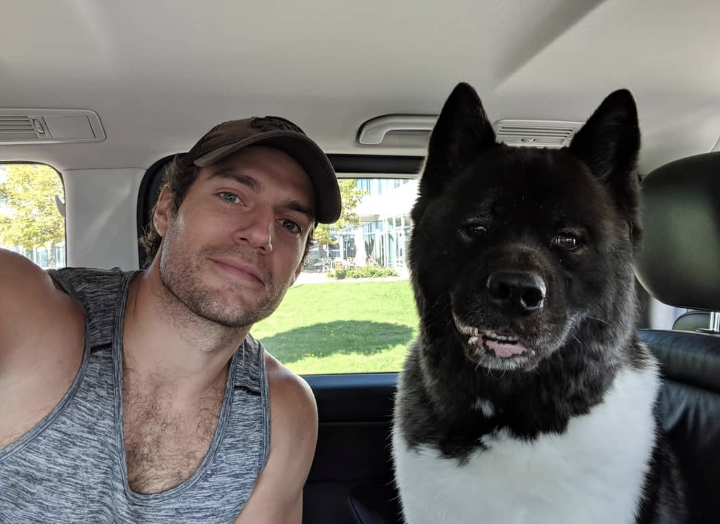 """""""Another day in Paradise, another day's training complete on The Witcher! The Bear has some crazy focus going on here. He's learning well.... #Witcher #Kal #BearSchool #Netflix""""   Henry Cavill, who posted this selfie with his dog, Kal, on Oct. 4, 2018"""
