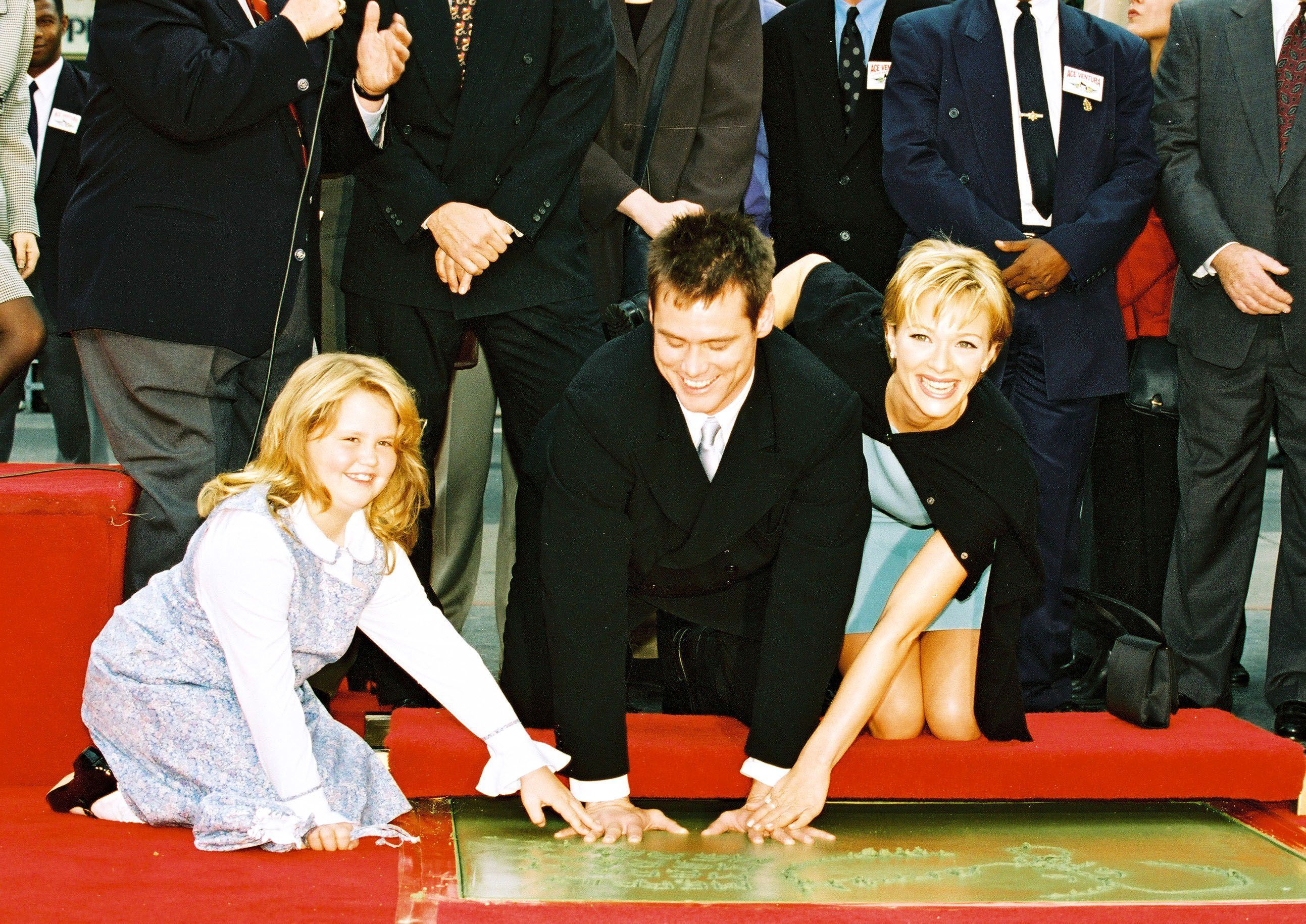 Jim Carrey got a little help from daughter Jane Carrey and then girlfriend Lauren Holly at his hand and footprint ceremony at Mann's Chinese Theatre in Hollywood on Nov. 11, 1995.