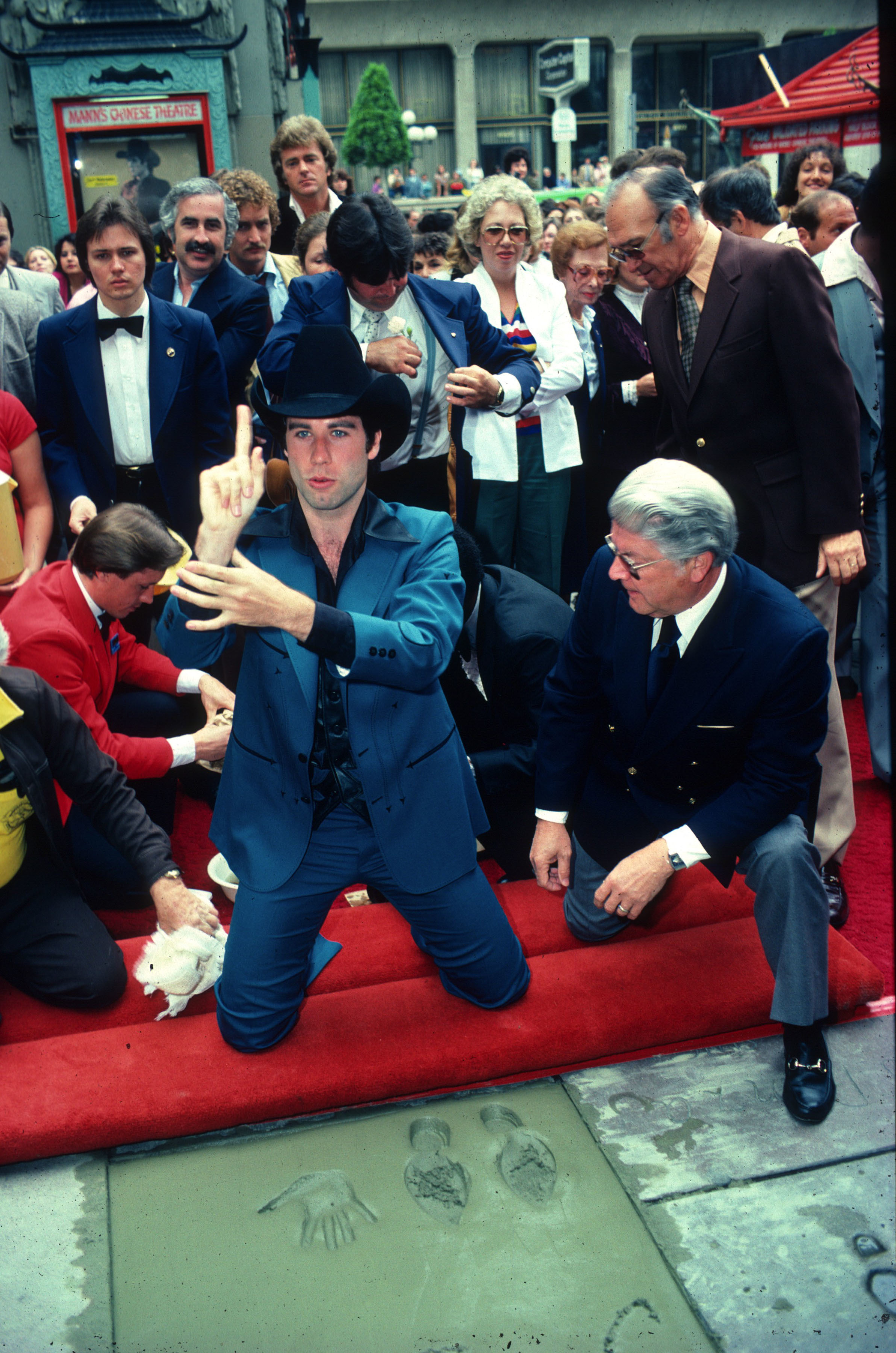 John Travolta left his footprints and handprints in concrete outside Manns Chinese Theatre in Hollywood on June 2, 1980.