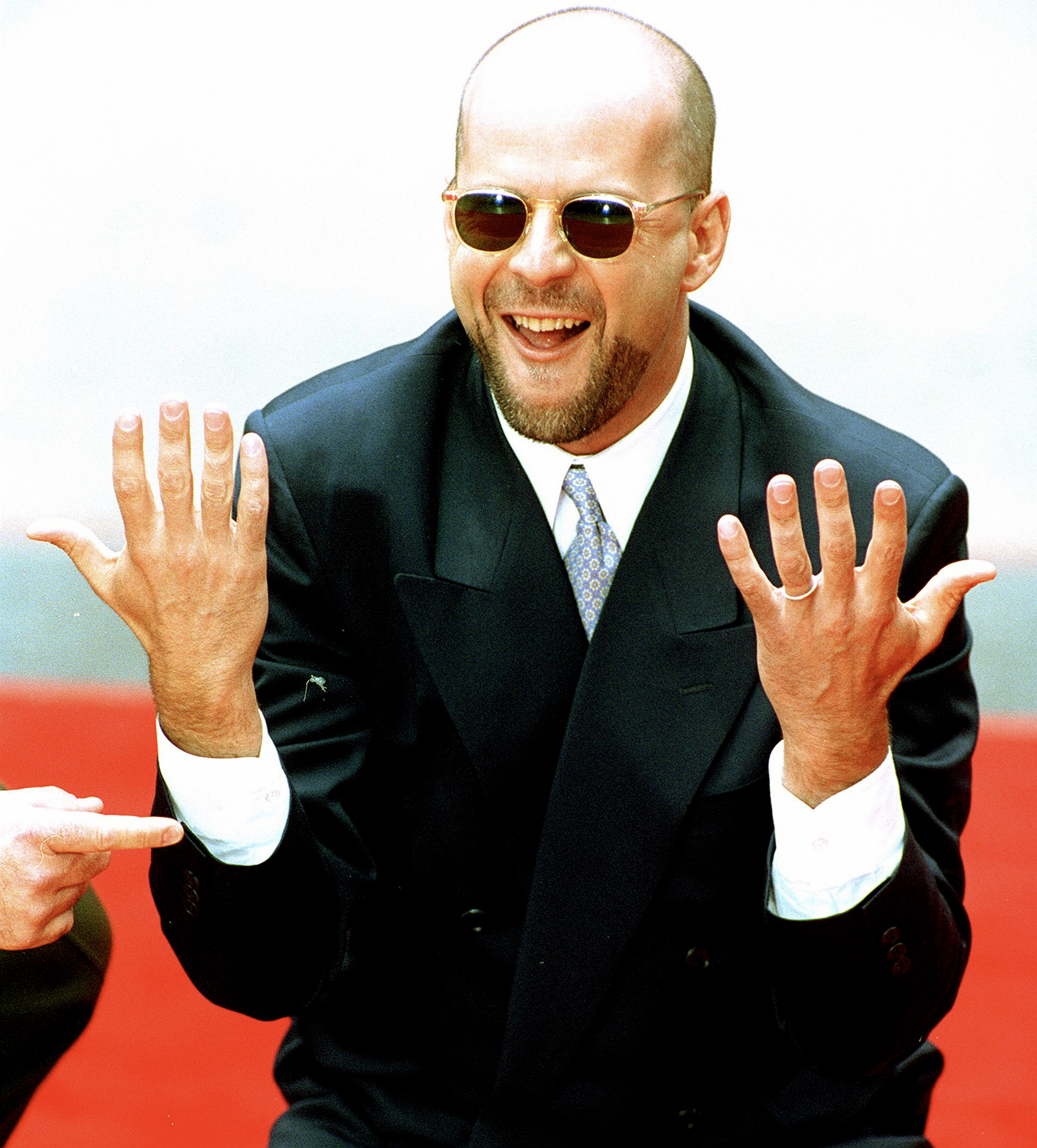 Bruce Willis leaves his handprints in cement at Mann's Chinese Theatre in Hollywood on May 18, 1995.