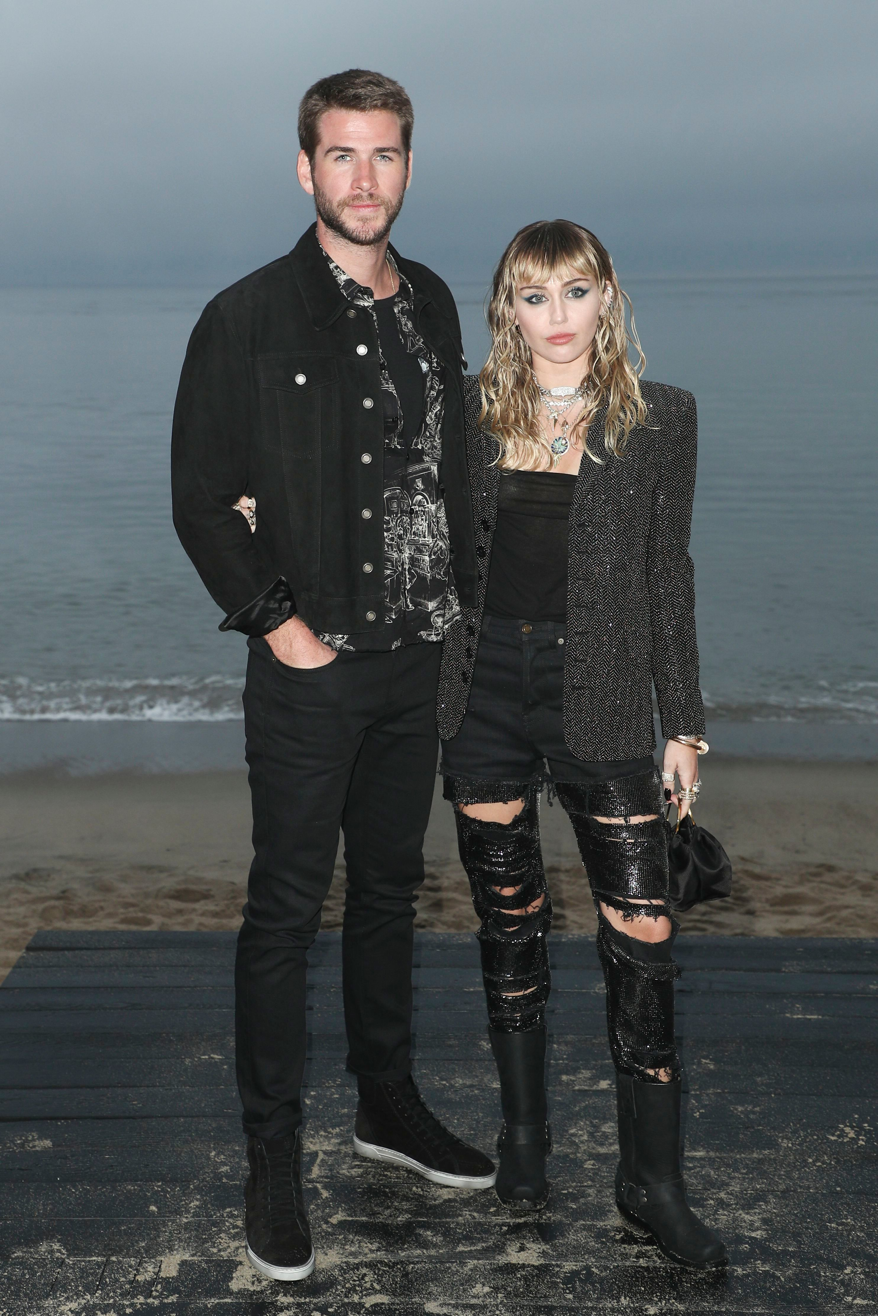 Liam Hemsworth and Miley Cyrus attend the Saint Laurent Show for Spring/Summer 2020 in Los Angeles on June 6, 2019.