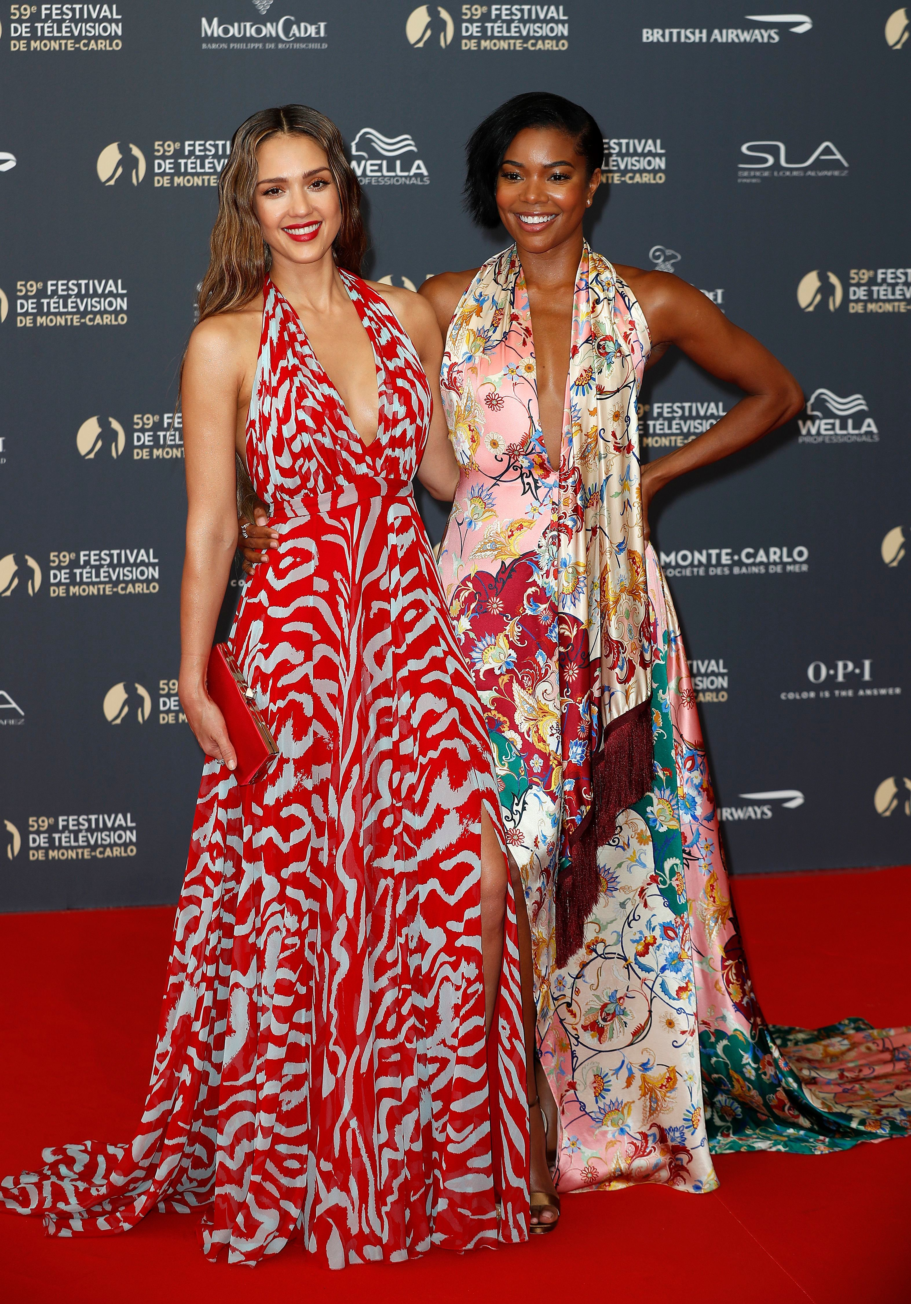 Jessica Alba and Gabrielle Union pose on the red carpet while arriving for the opening ceremony of the 59th Monte Carlo Television Festival in Monaco on June 14, 2019.