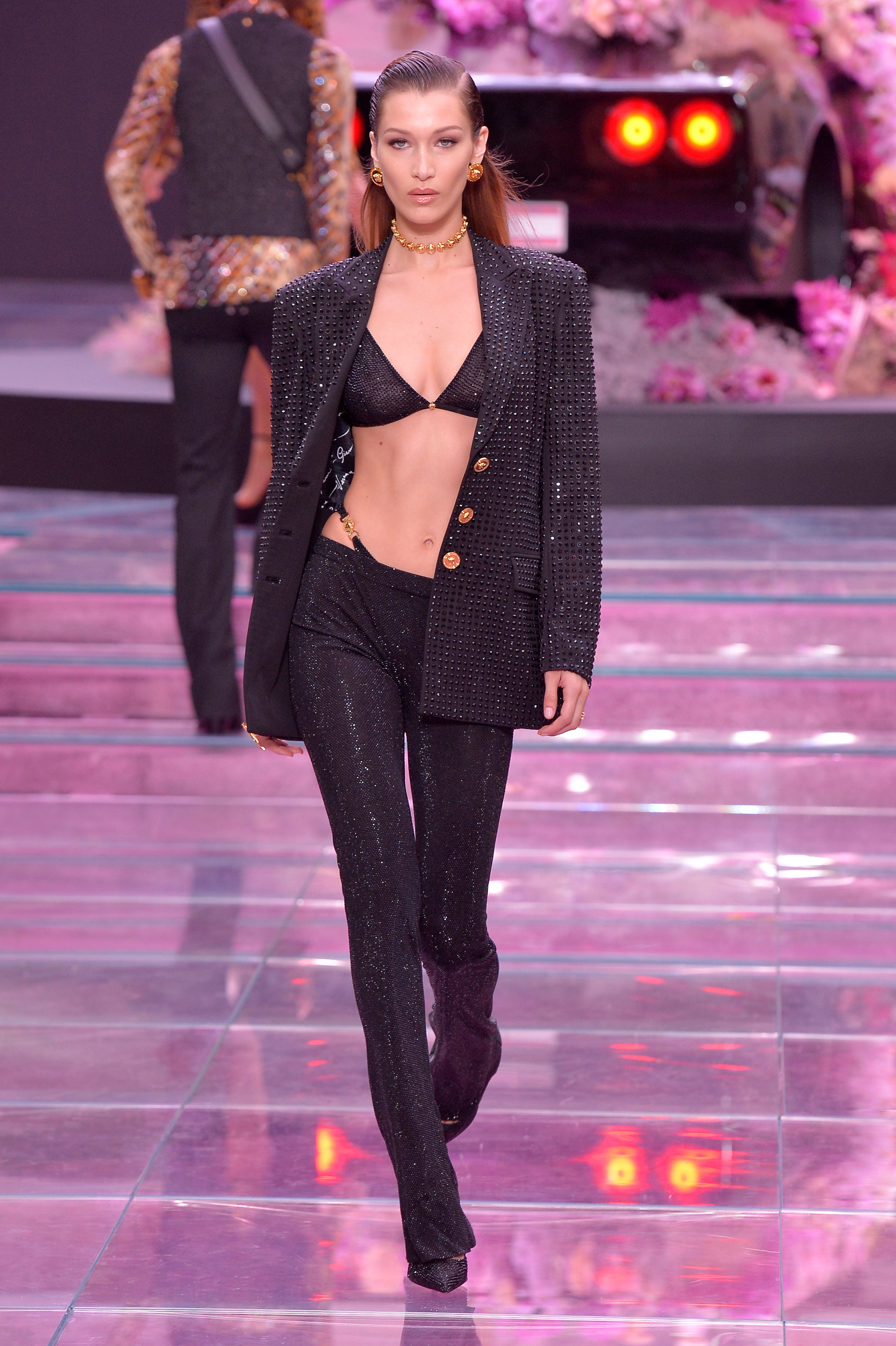 Bella Hadid walks on the catwalk for the Versace show for Spring/Summer 2020 at Milan Fashion Week Men's on June 15, 2019.