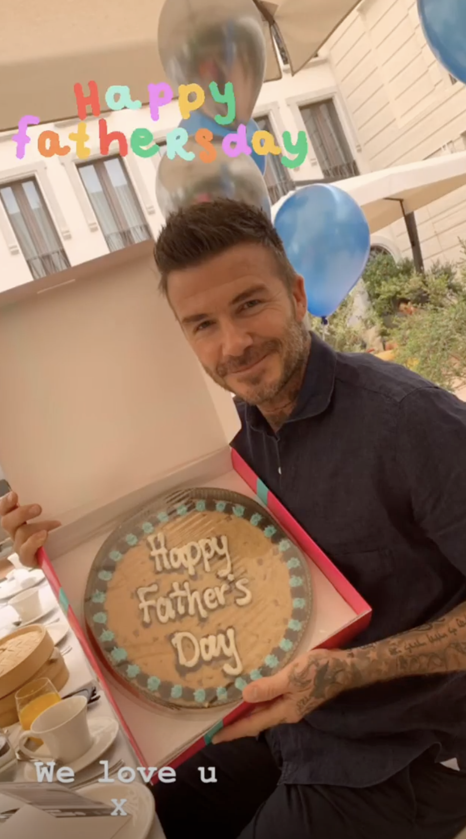 Victoria Beckham posted this photo of husband David Beckham holding up a Father's Day 2019 cookie cake on her Instagram Story on June 16, 2019.