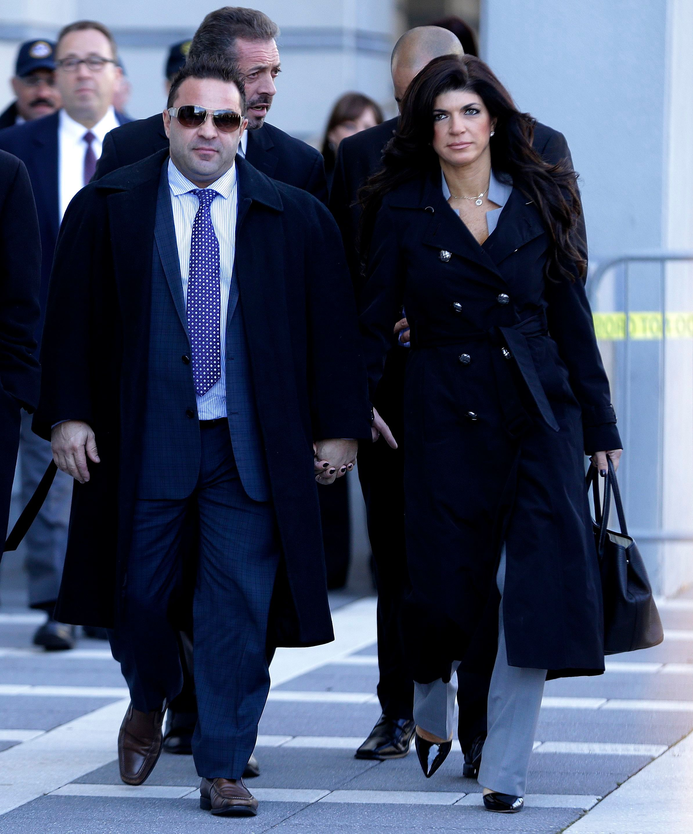 Joe Giudice and Teresa Giudice walk out of Martin Luther King, Jr. Courthouse in Newark, New Jersey,  on Nov. 20, 2013.
