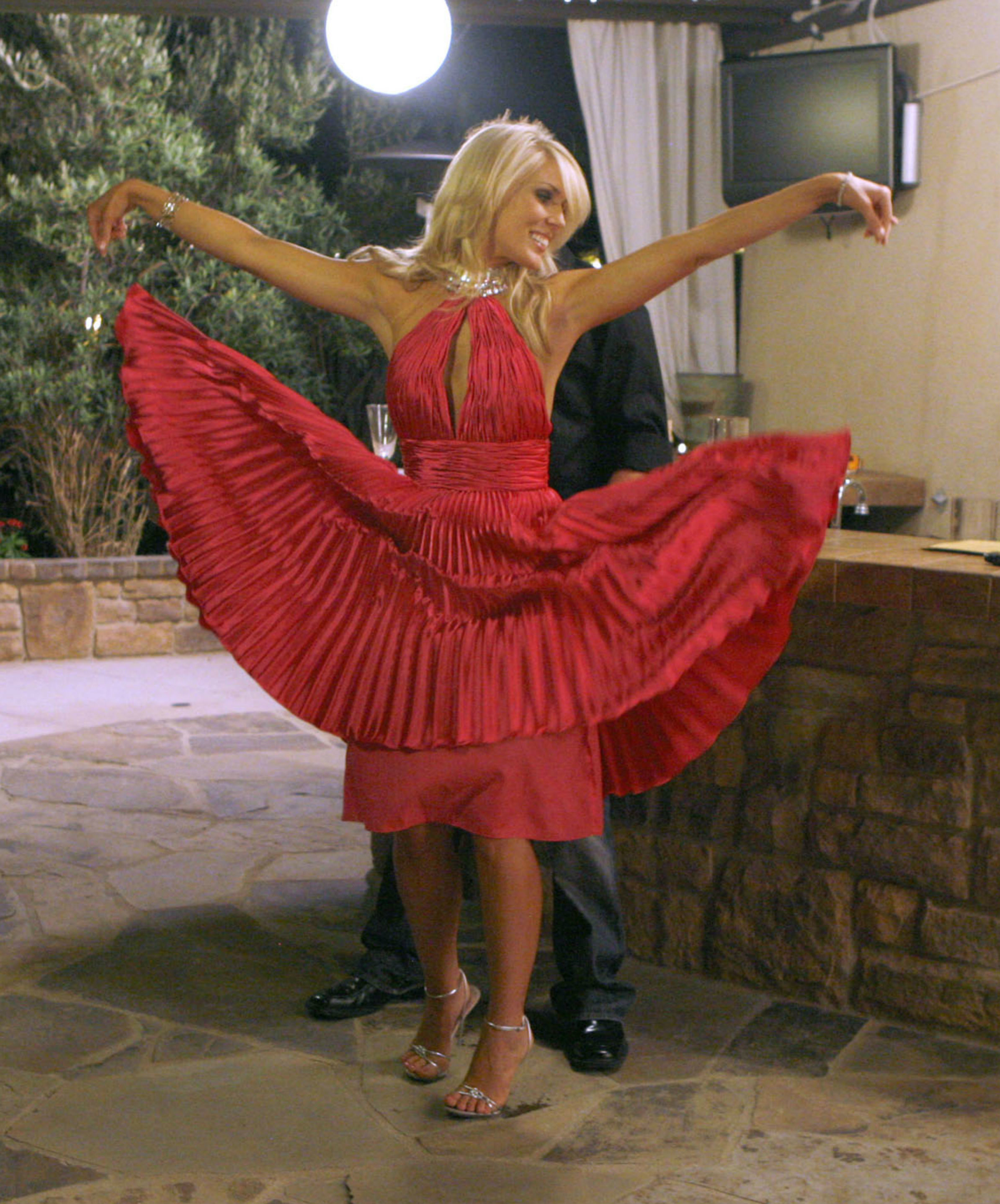 "Gretchen Rossi appears on the fourth season of ""The Real Housewives of Orange County"" in 2009."