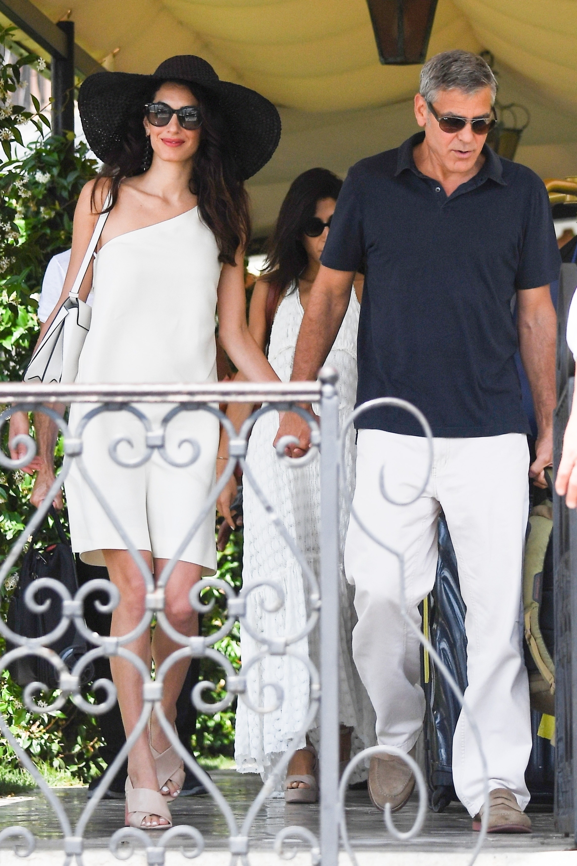 George and Amal Clooney were seen walking hand in hand as they left their hotel in Venice, Italy on June 28, 2019.