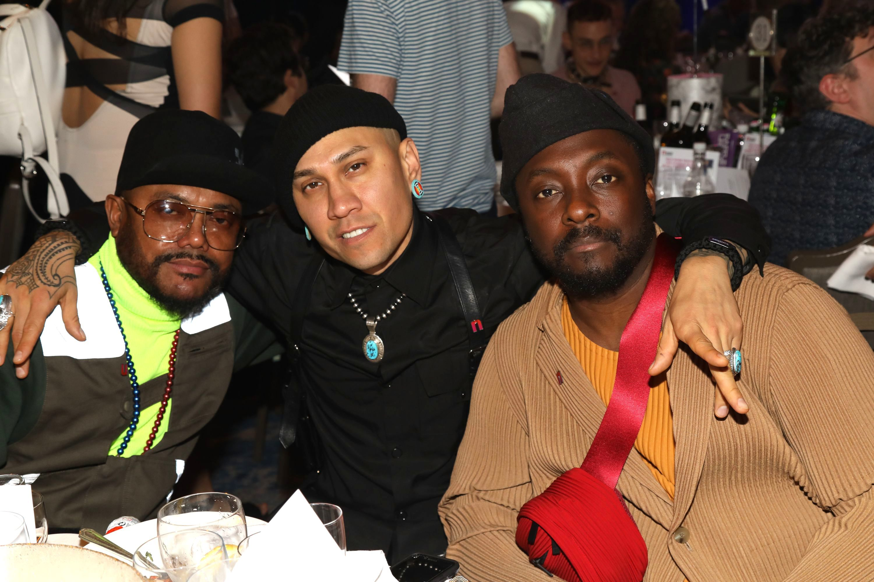 Black Eyed Peas members apl.de.ap, Taboo and will.i.am pose together at the O2 Silver Clef Awards in support of 