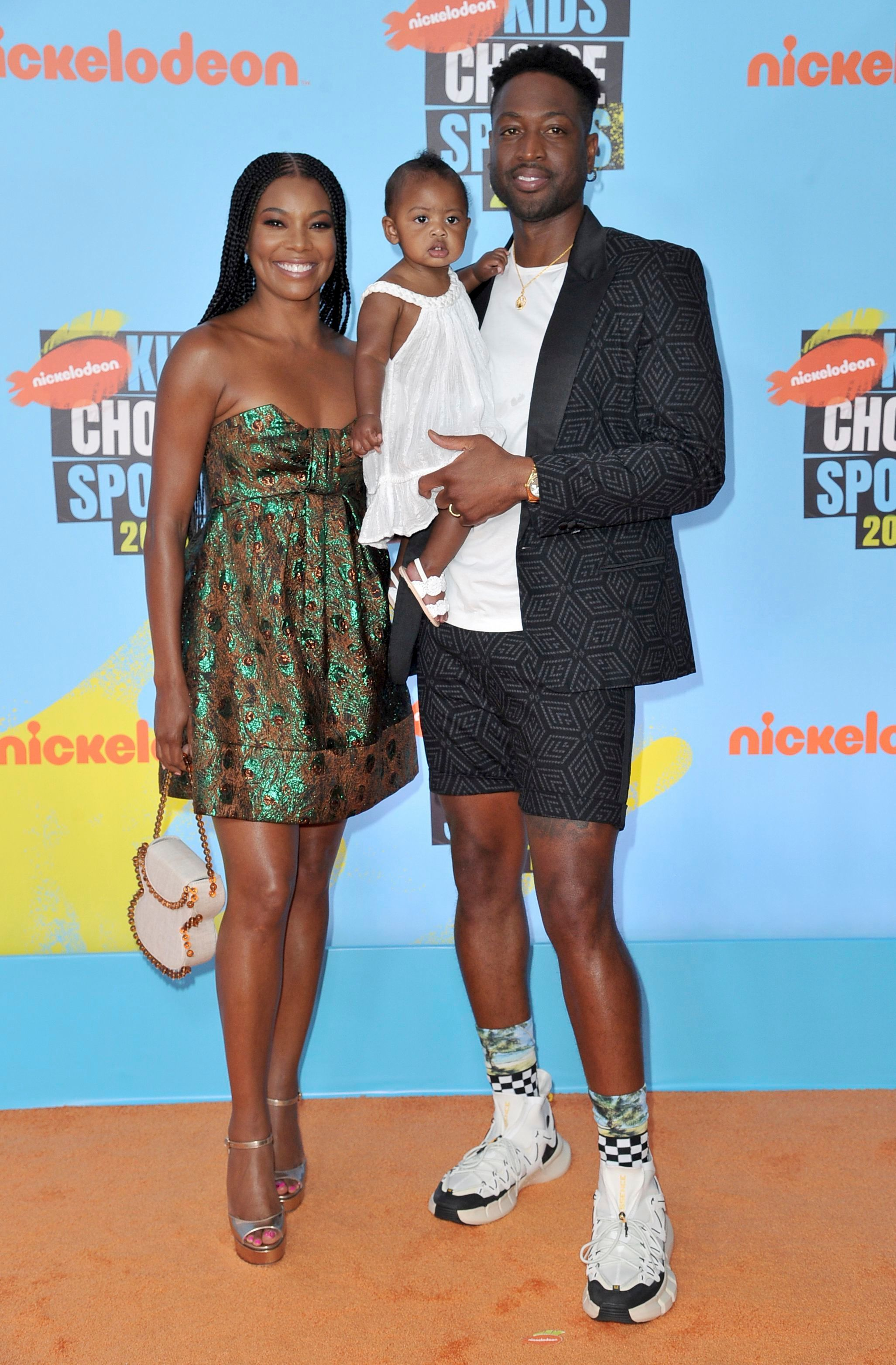 Gabrielle Union, Dwayne Wade, and their daughter Kaavia James Union Wade arrive at the Kids' Choice Sports Awards in Los Angeles on July 11, 2019.