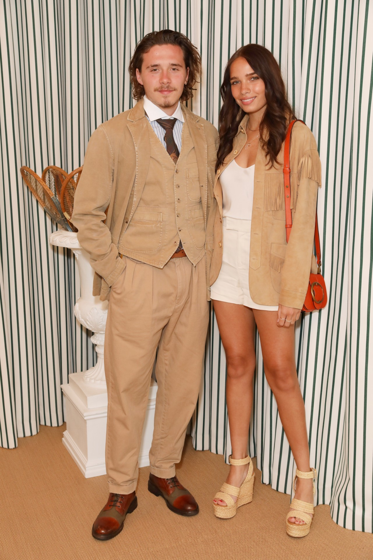 Brooklyn Beckham and Hana Cross stop by the Polo Ralph Lauren suite during the Wimbledon Tennis Championships at All England Lawn Tennis and Croquet Club in London on July 14, 2019.