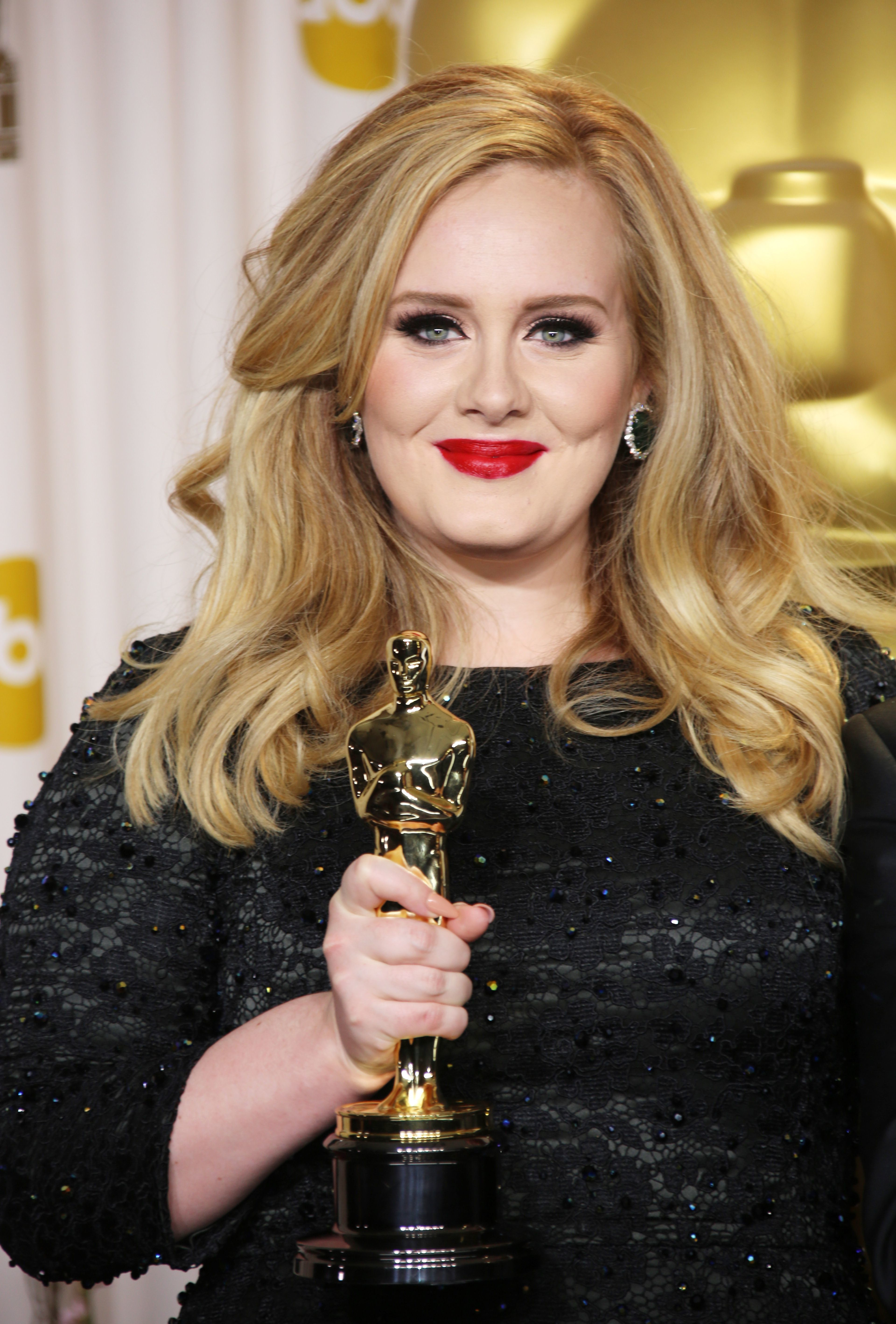 """Adele holds her Oscar for best original song for """"Skyfall"""" in the press room at the  85th Annual Academy Awards in Hollywood on Feb. 24, 2013."""