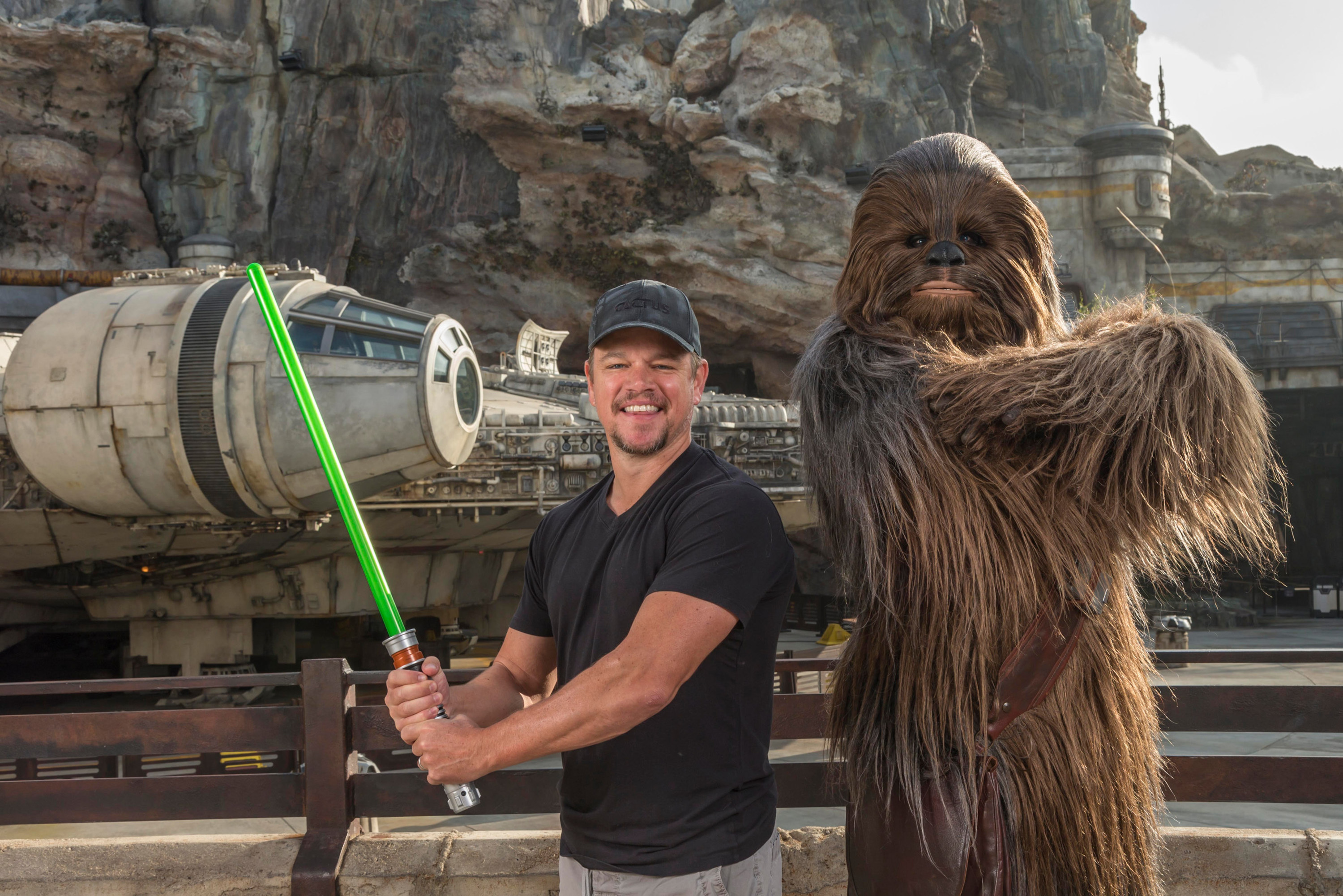Matt Damon encounters Chewbacca in front of Millennium Falcon: Smugglers Run attraction at the new Star Wars: Galaxy's Edge land at Disneyland in Anaheim, California, on Aug. 5, 2019.