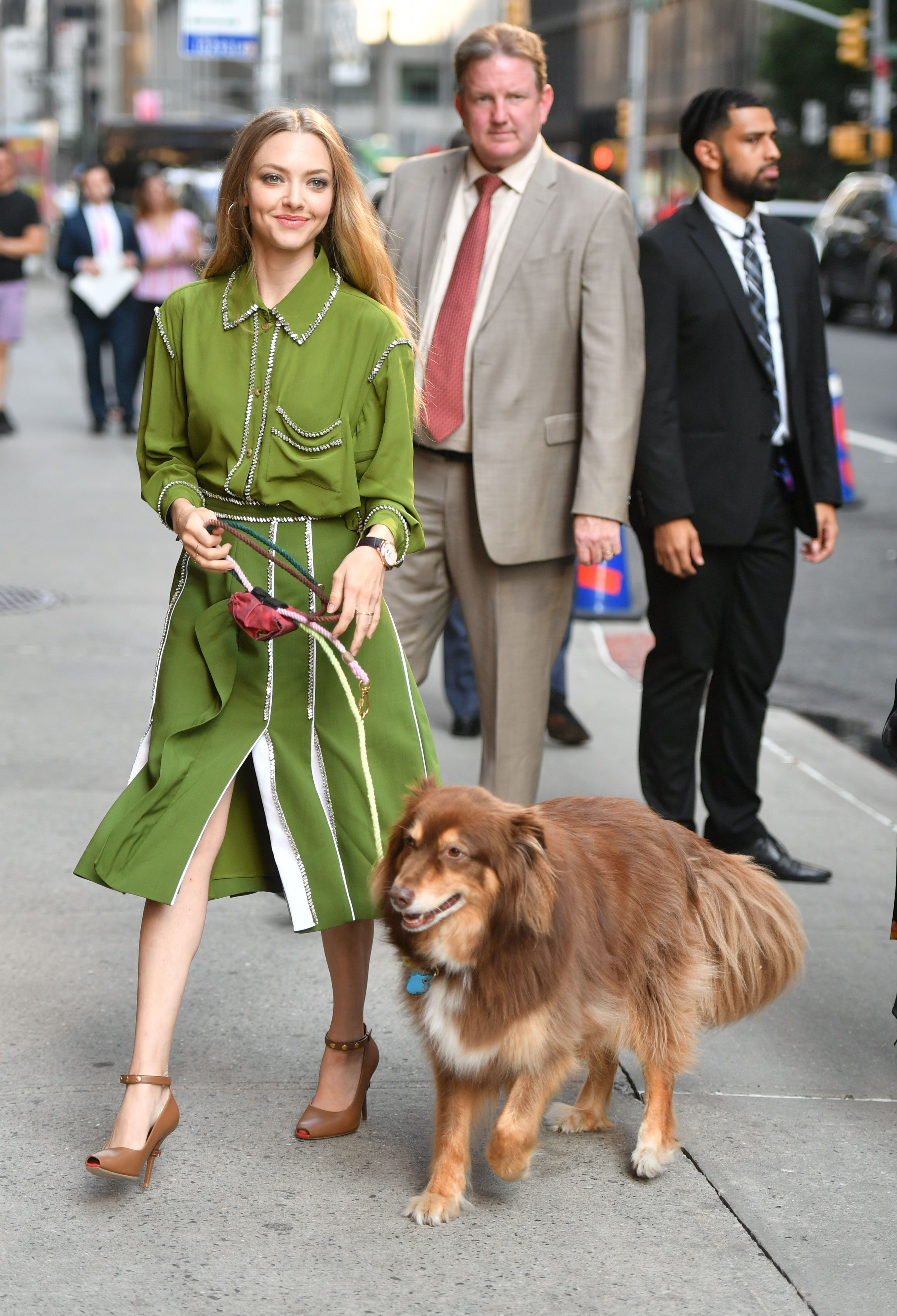 """Amanda Seyfried and her dog Finn arrived at the """"Late Show with Stephen Colbert"""" TV show studios in New York City on Aug. 6, 2019."""