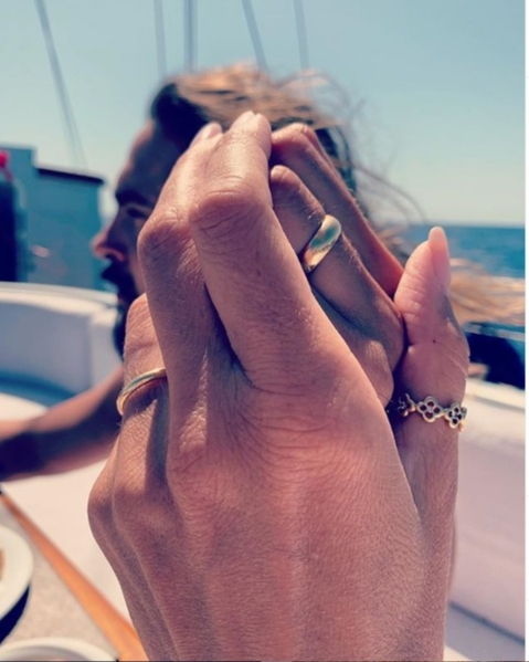 Heidi Klum shares a photo of her hand entwined with her husband, Tom Kaulitz's hand in the first photo of their wedding rings on Aug. 14, 2019.