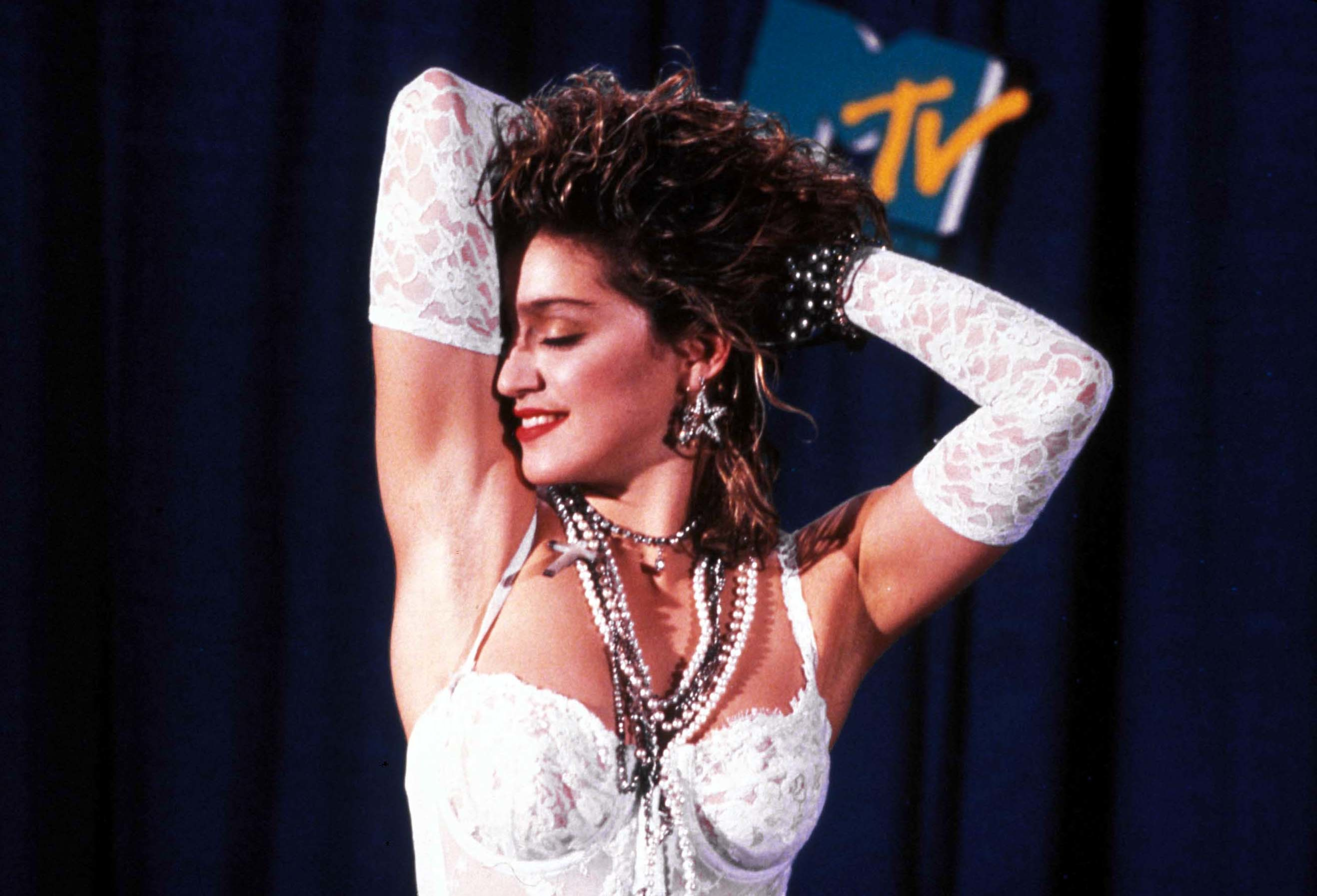 Madonna poses at the 1984 MTV Video Music Awards at the Radio City Music Hall in New York City on Sept. 14, 1984.