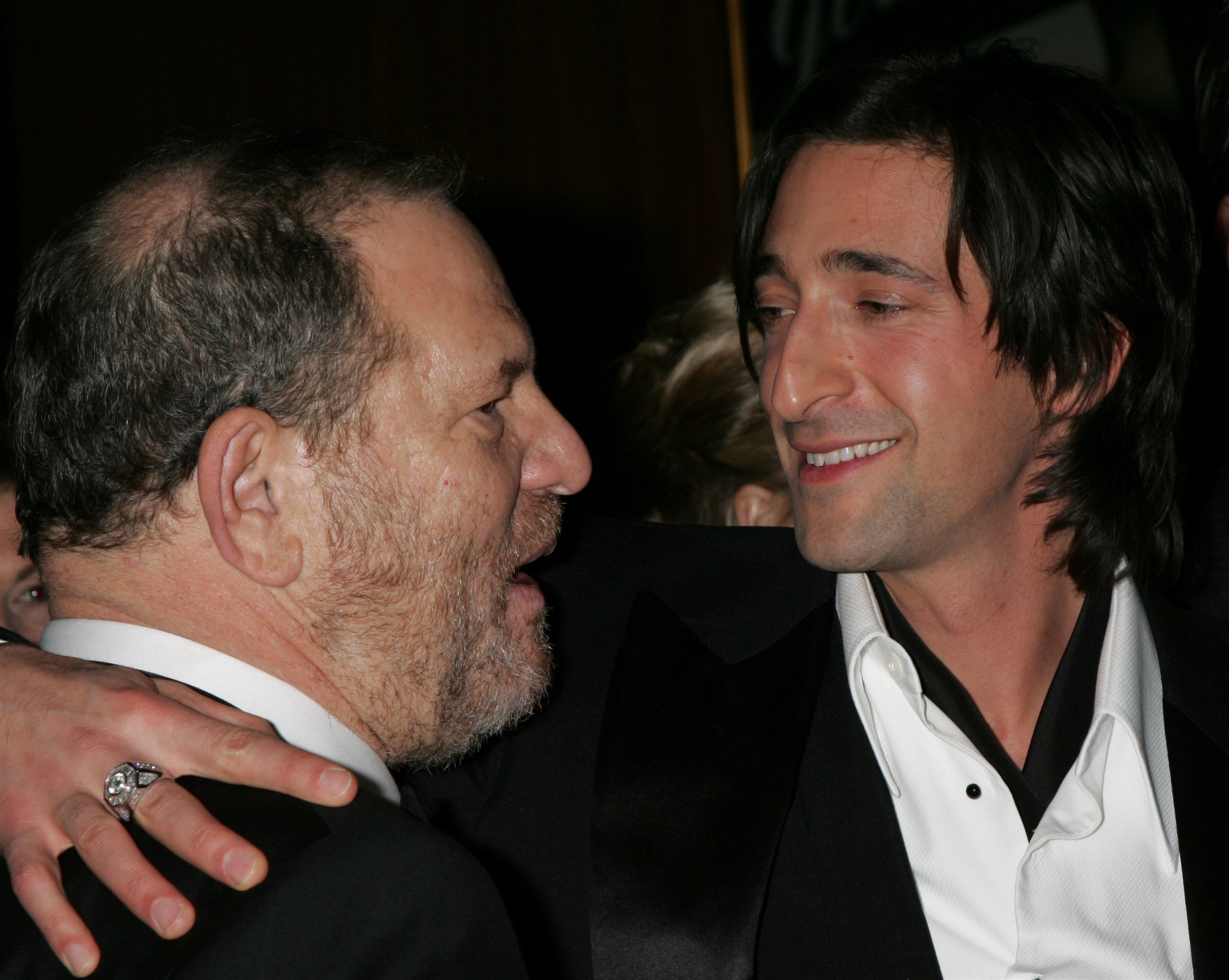Producer Harvey Weinstein and actor Adrien Brody talk at the Weinstein Company's Golden Globes afterparty at Trader Vic's in Beverly Hills on Jan. 16, 2006.
