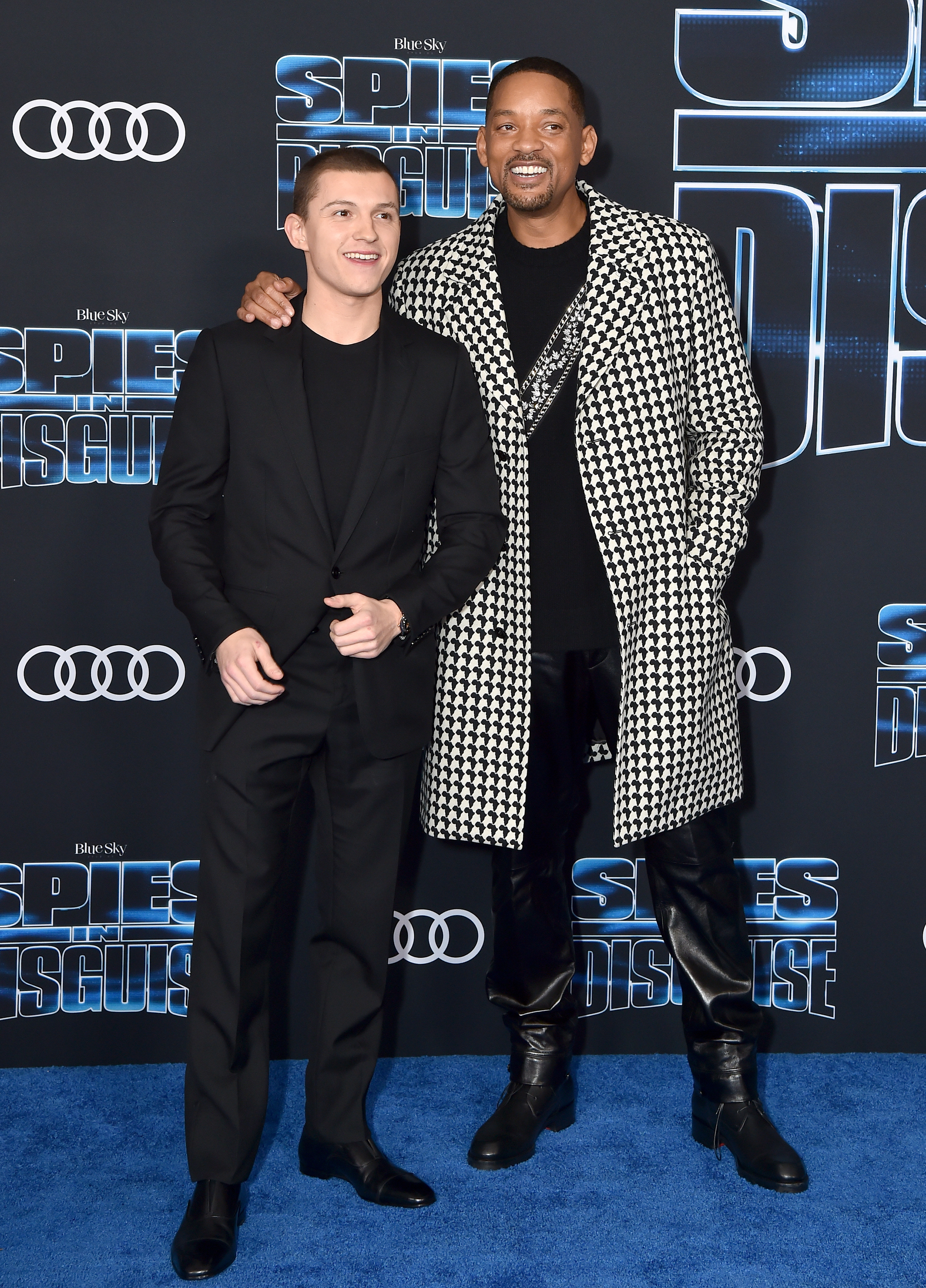 """Tom Holland and Will Smith attend the premiere of 20th Century Fox's """"Spies in Disguise"""" at El Capitan Theatre in Los Angeles on Dec. 4, 2019."""