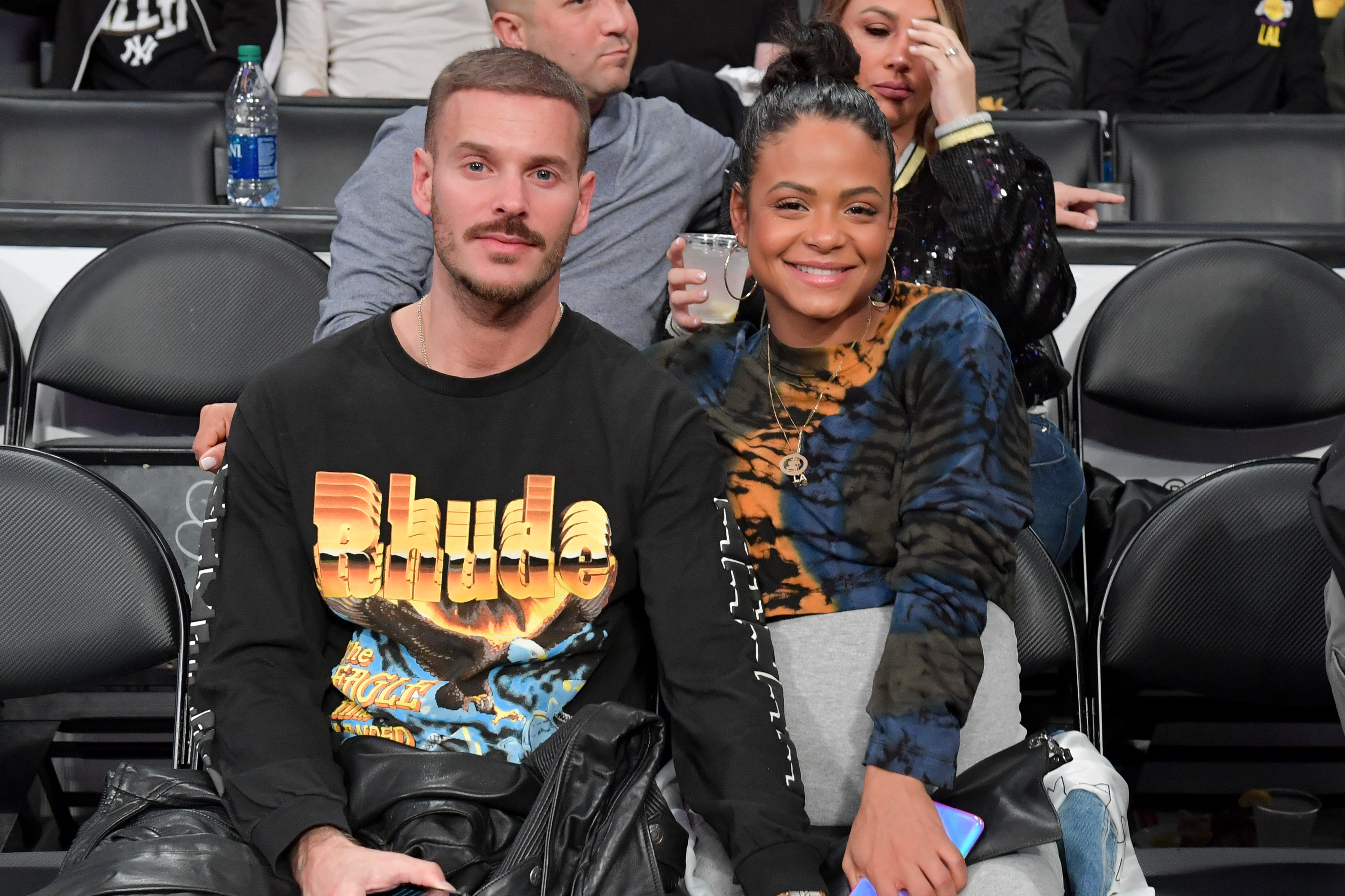Matt Pokora and Christina Milian watch the Los Angeles Lakers play the Phoenix Suns at the Staples Center in Los Angeles on Jan. 1, 2020.